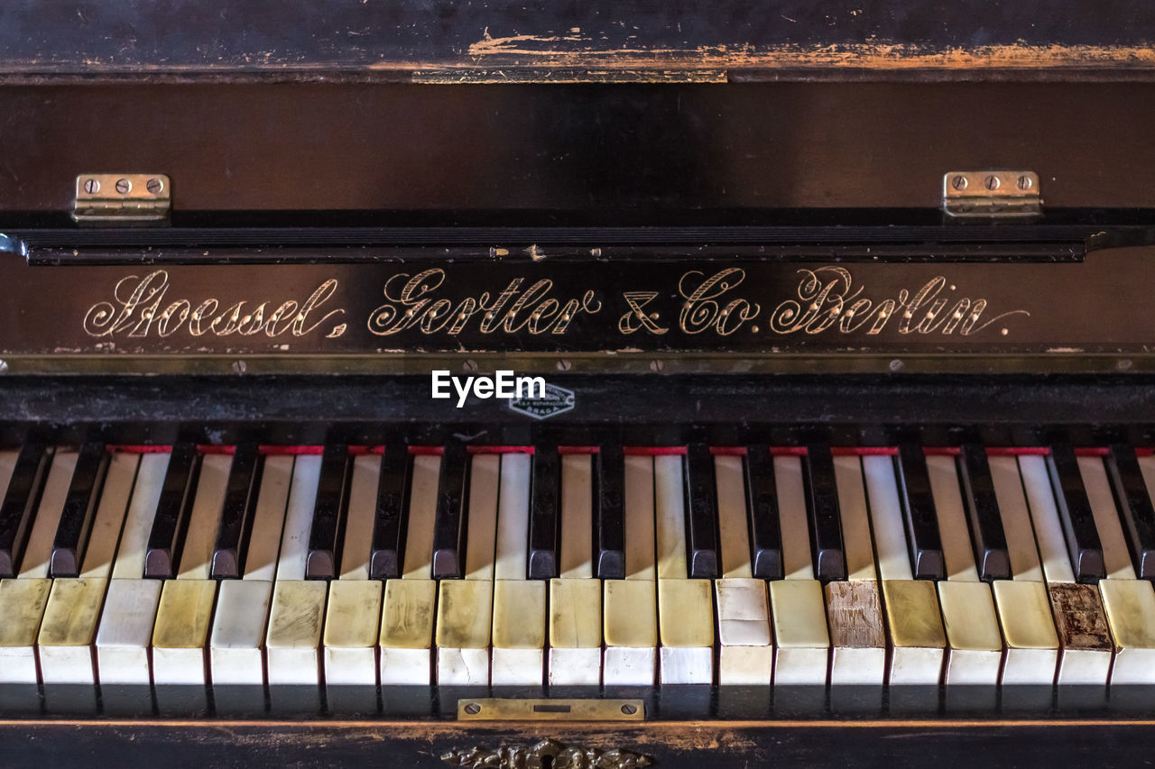 text, music, musical instrument, no people, piano key, typewriter, piano, indoors, close-up, day