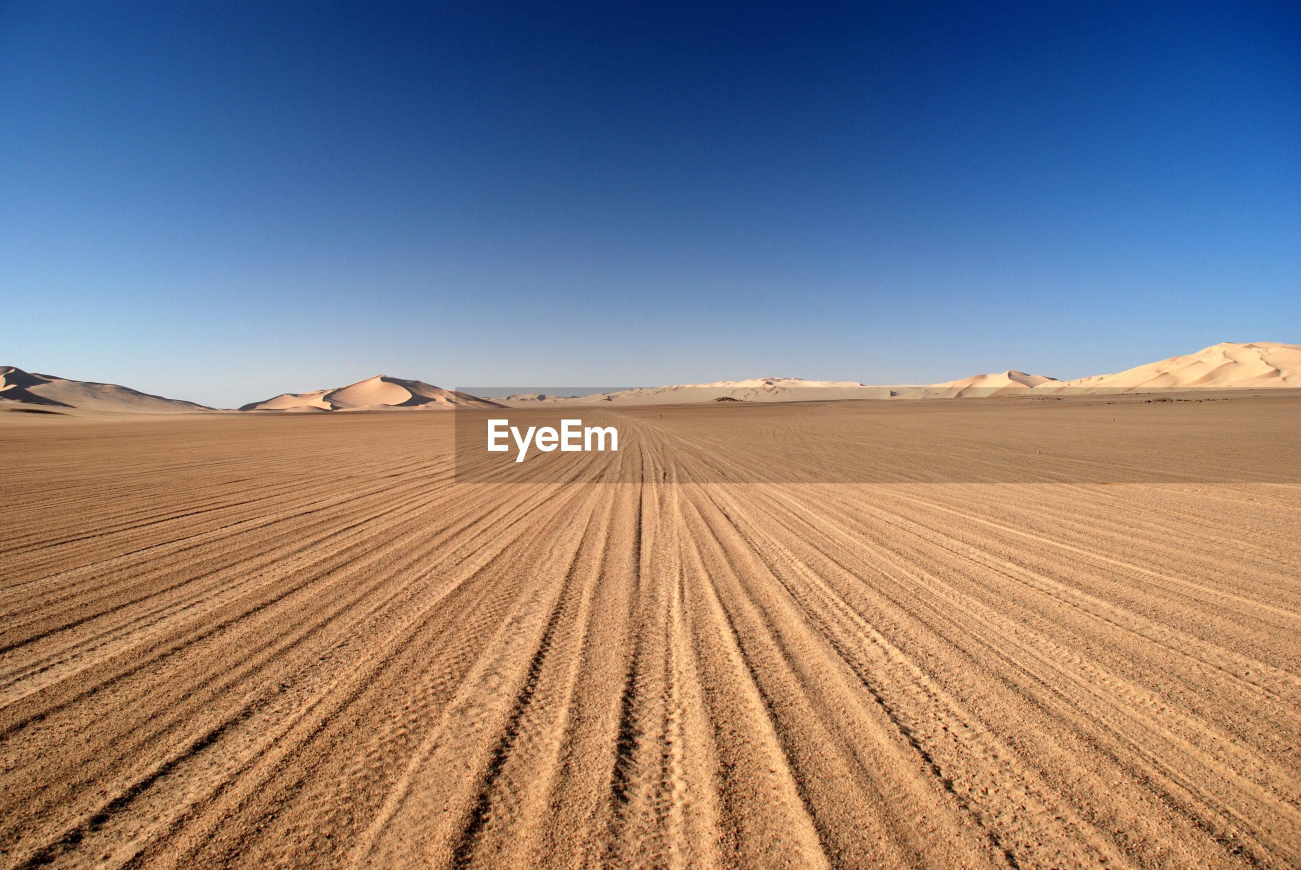 Tire track on sand in desert