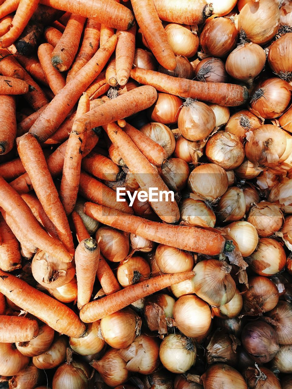 Full Frame Shot Of Carrots And Onions