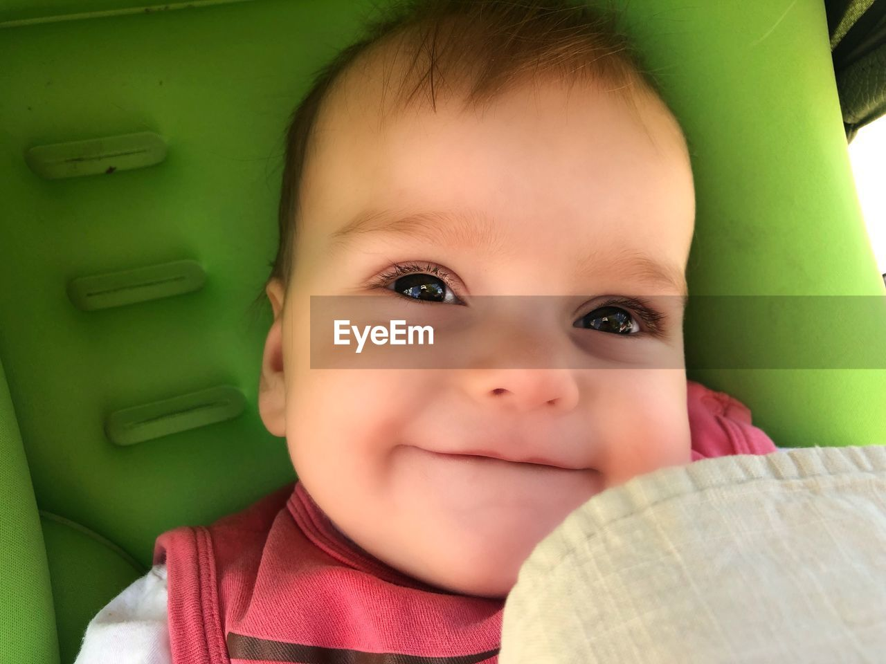 Close-Up Of Smiling Cute Baby Boy In Stroller