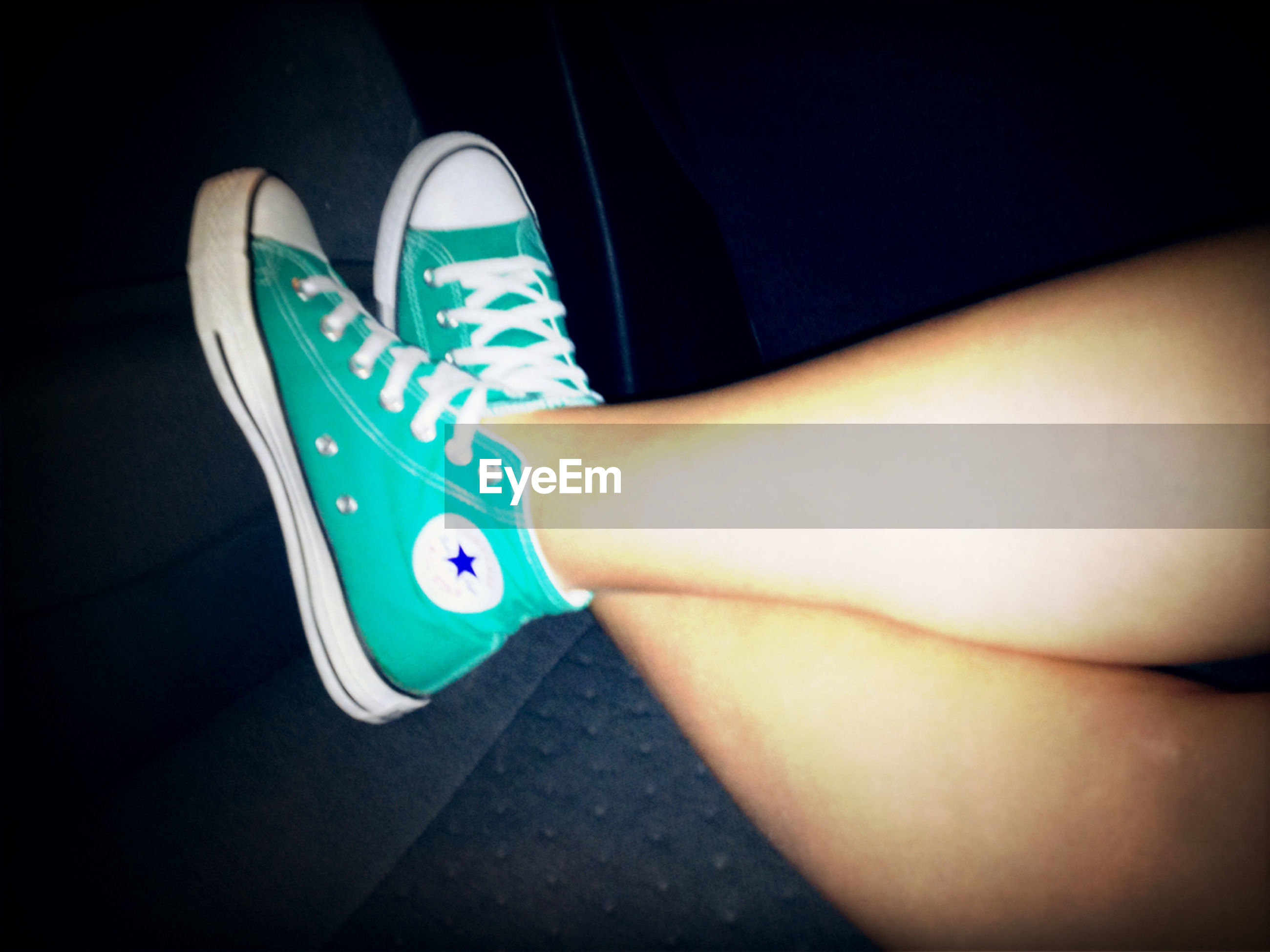 low section, blue, indoors, person, high angle view, part of, lifestyles, text, multi colored, personal perspective, close-up, unrecognizable person, leisure activity, communication, shoe