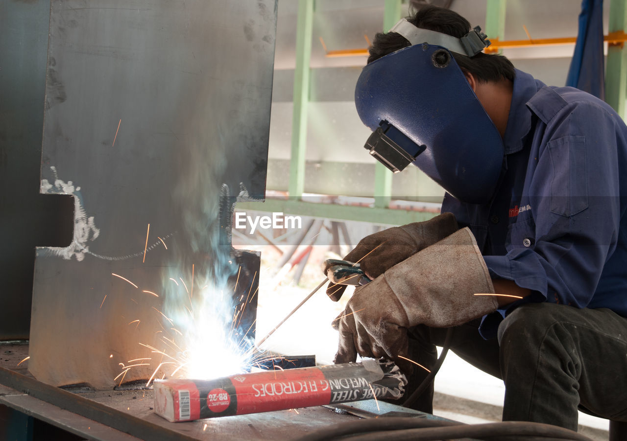 MAN WORKING ON FACTORY