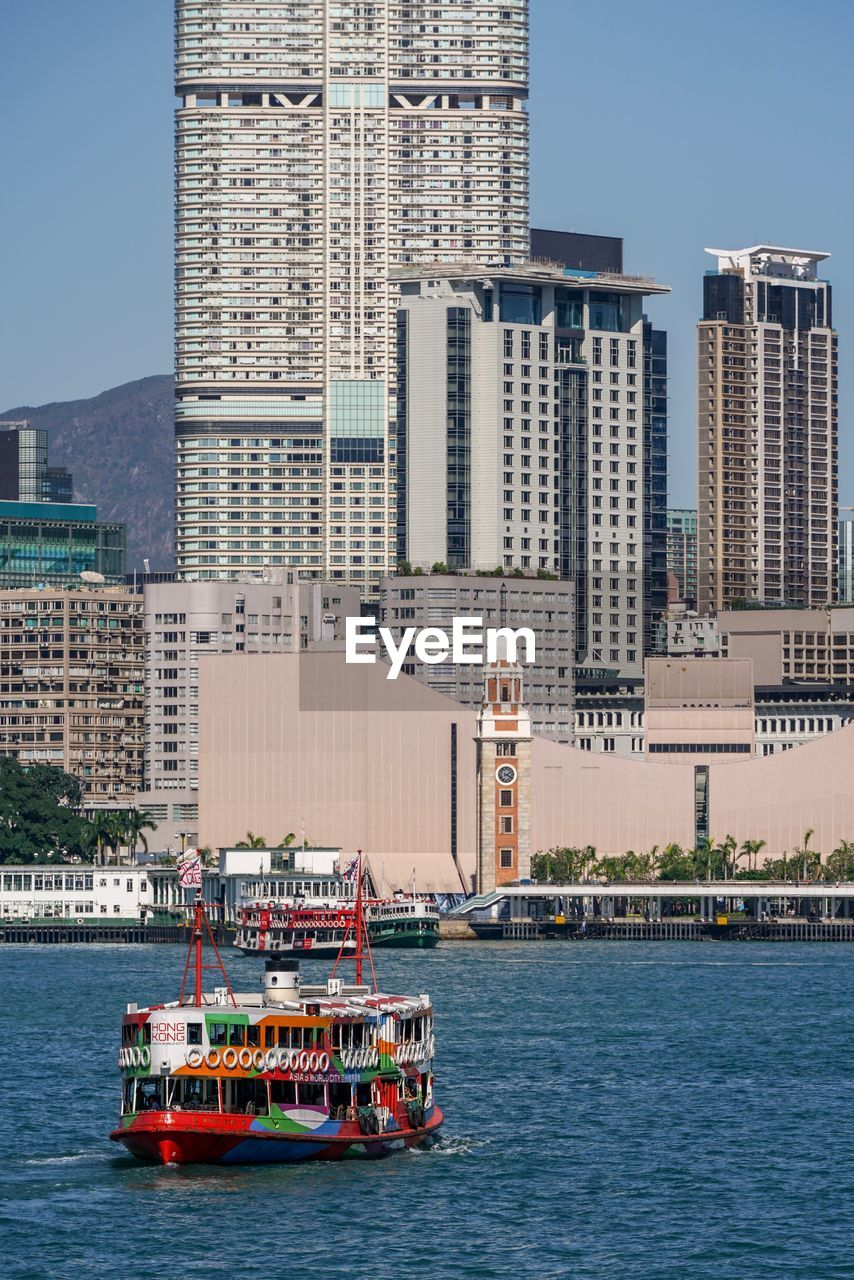 building exterior, architecture, built structure, water, mode of transportation, transportation, city, building, nautical vessel, office building exterior, waterfront, day, sky, nature, sea, tower, travel, skyscraper, craft, outdoors, passenger craft, cityscape