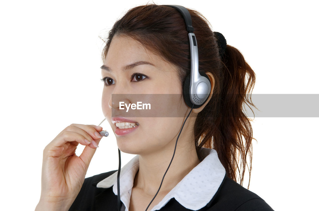 Customer service representative wearing headset against white background