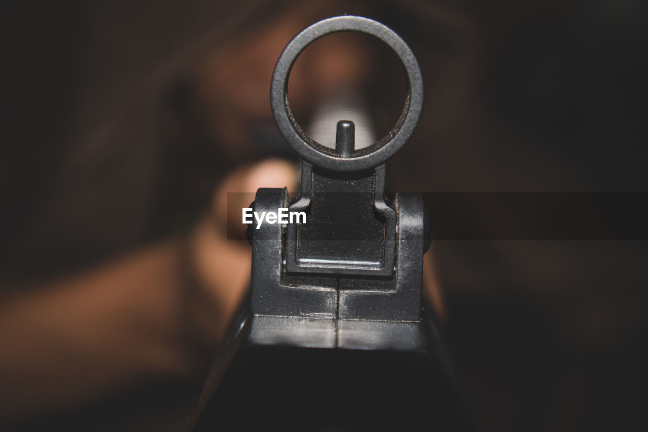 close-up, metal, no people, indoors, black color, focus on foreground, still life, single object, selective focus, security, gun, studio shot, weapon, technology, table, retro styled, man made, equipment, violence, aggression
