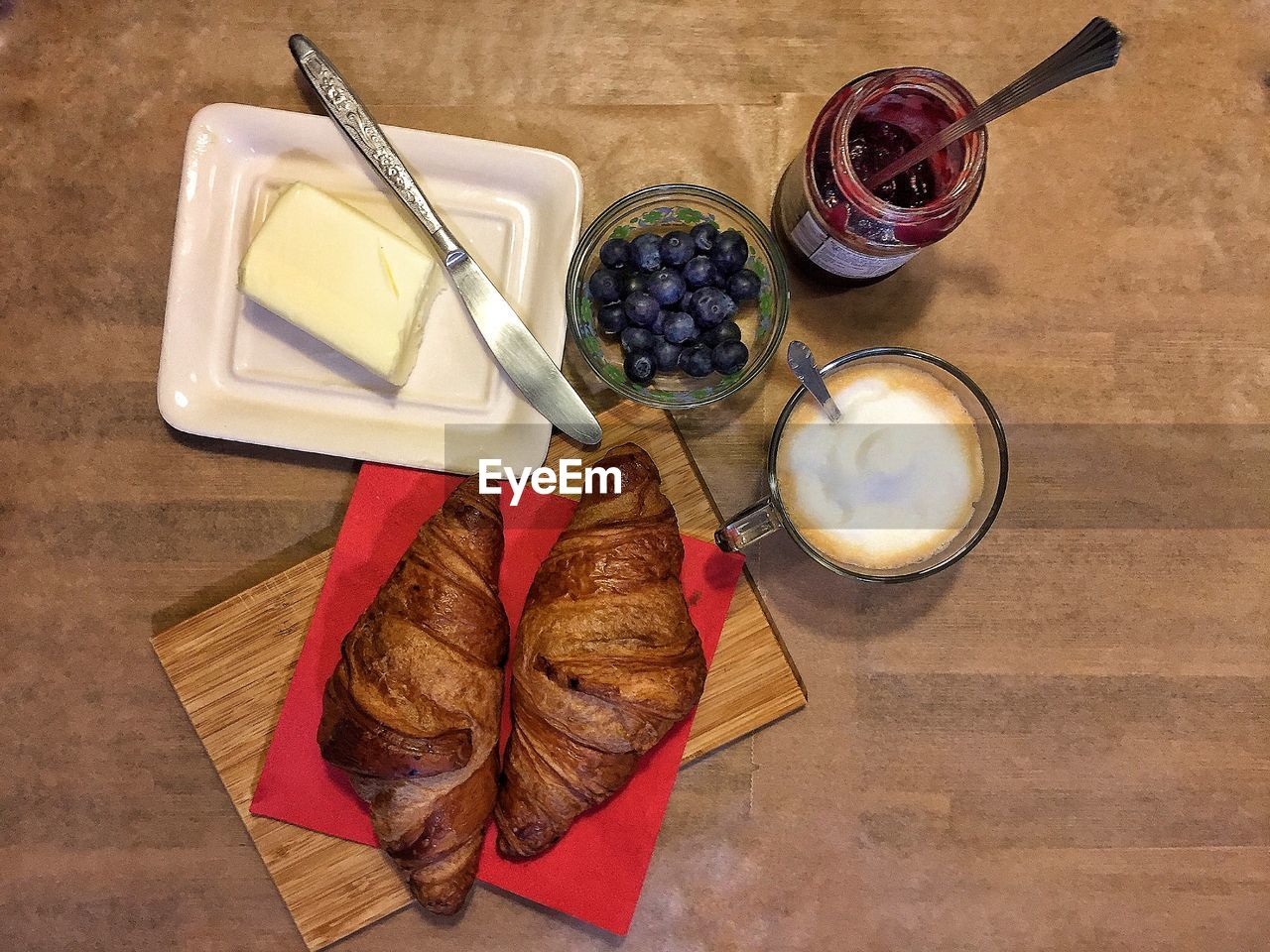 food and drink, food, freshness, healthy eating, table, fruit, high angle view, berry fruit, wellbeing, directly above, still life, kitchen utensil, indoors, eating utensil, drink, refreshment, spoon, bread, bowl, glass, breakfast, meal, tray
