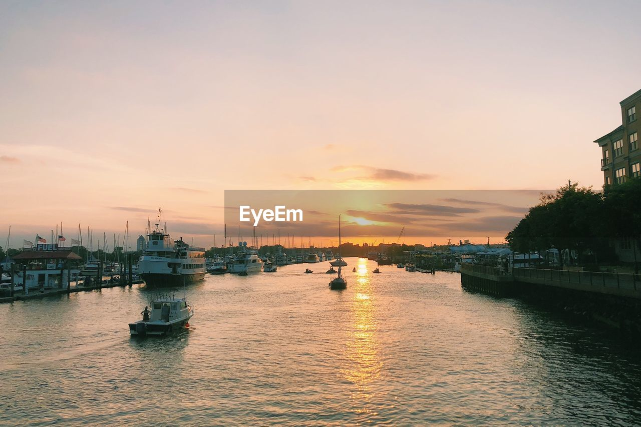 sky, sunset, nautical vessel, water, transportation, waterfront, mode of transportation, orange color, nature, architecture, no people, sea, beauty in nature, scenics - nature, cloud - sky, city, building exterior, built structure, outdoors, passenger craft, marina, bay