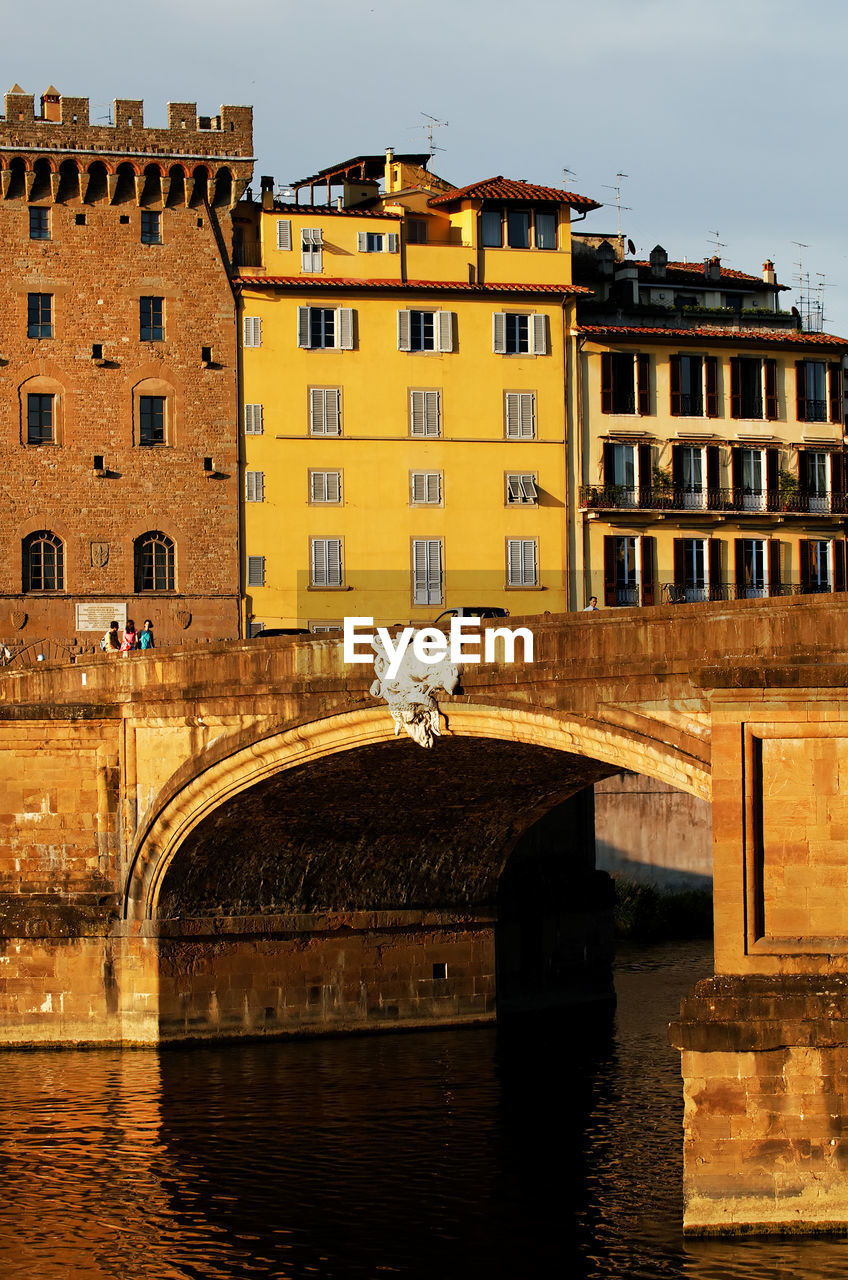 Ponte Santa Trinita Over Arno River In Tuscany Against Sky