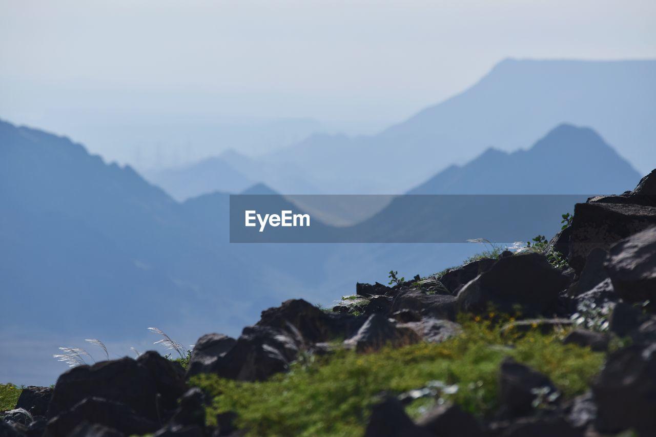 mountain, scenics - nature, mountain range, beauty in nature, sky, nature, tranquil scene, tranquility, rock, plant, rock - object, non-urban scene, no people, environment, solid, day, outdoors, idyllic, remote, tree, mountain peak