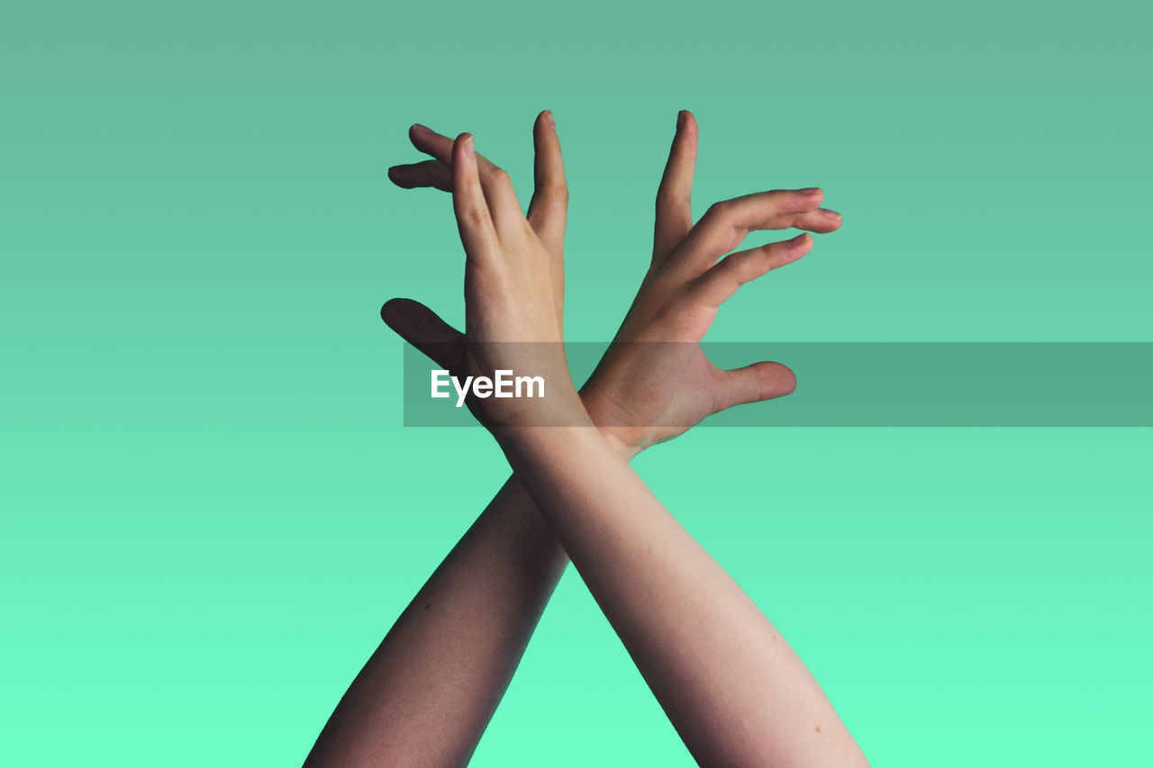 Woman's hands against green background