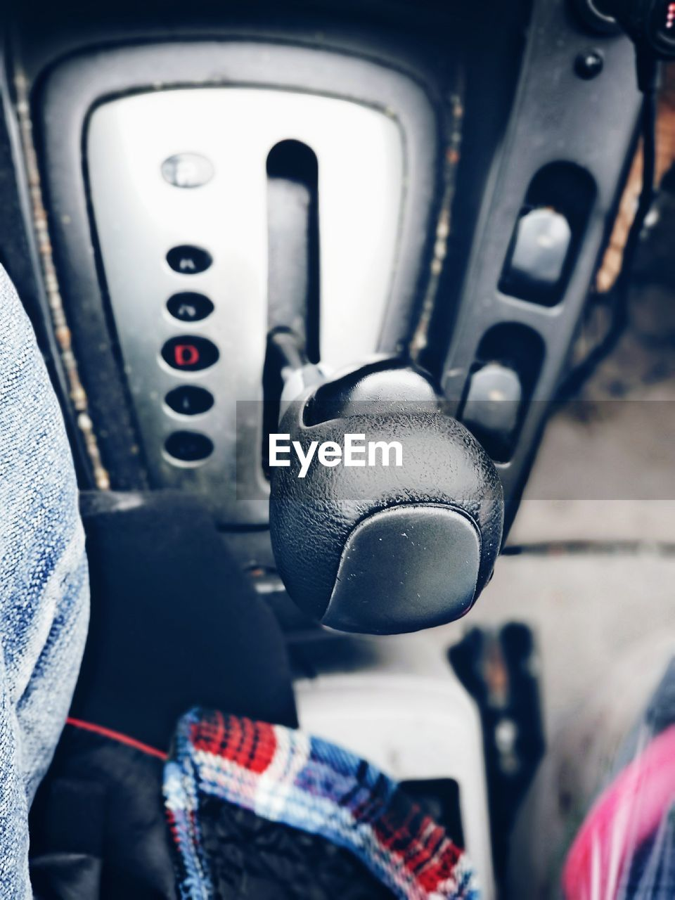 vehicle interior, mode of transportation, transportation, land vehicle, control, travel, close-up, gearshift, car, motor vehicle, real people, technology, people, communication, day, focus on foreground, indoors, vehicle seat, air vehicle