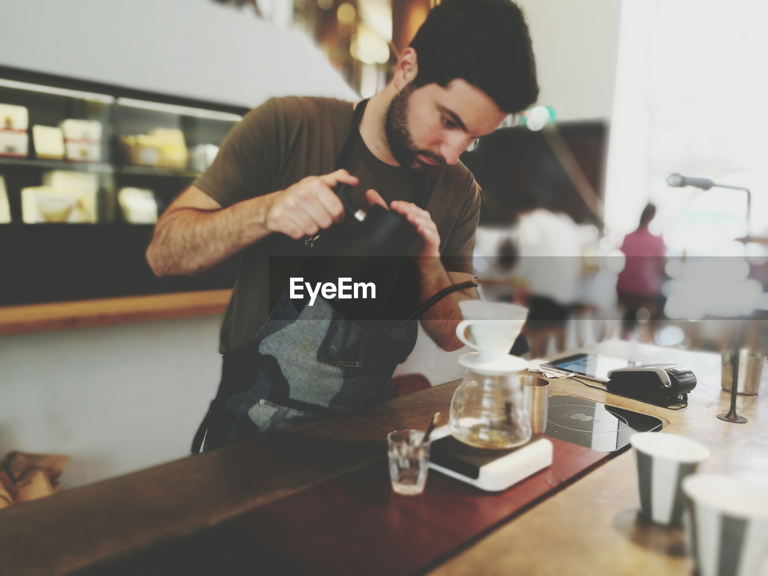 drink, coffee - drink, food and drink, men, indoors, real people, lifestyles, hipster - person, table, bar - drink establishment, tea - hot drink, bar counter, two people, young adult, working, adults only, freshness, adult, human hand, people, day