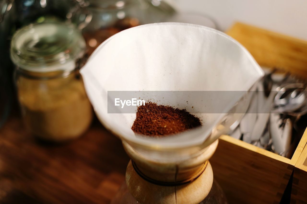 Close-Up Of Ground Coffee In Filter