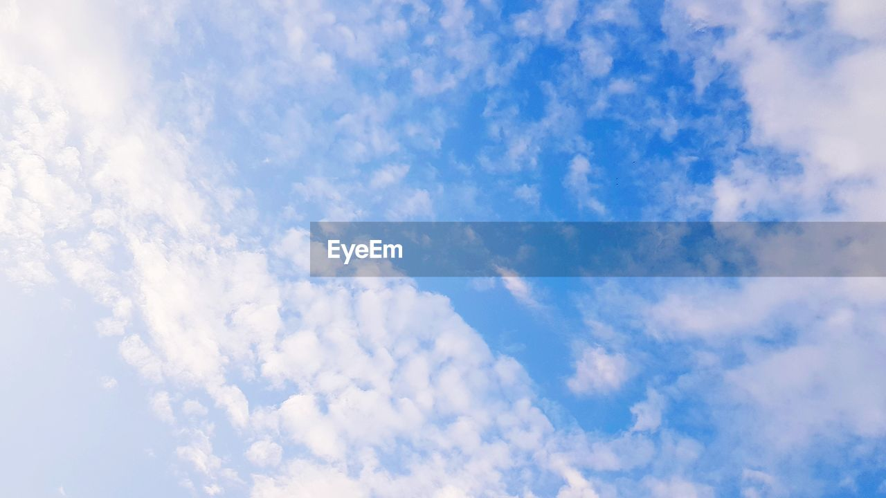 cloud - sky, sky, beauty in nature, low angle view, blue, tranquility, scenics - nature, no people, day, nature, white color, tranquil scene, backgrounds, outdoors, full frame, idyllic, non-urban scene, beauty, cloudscape, sunlight, meteorology