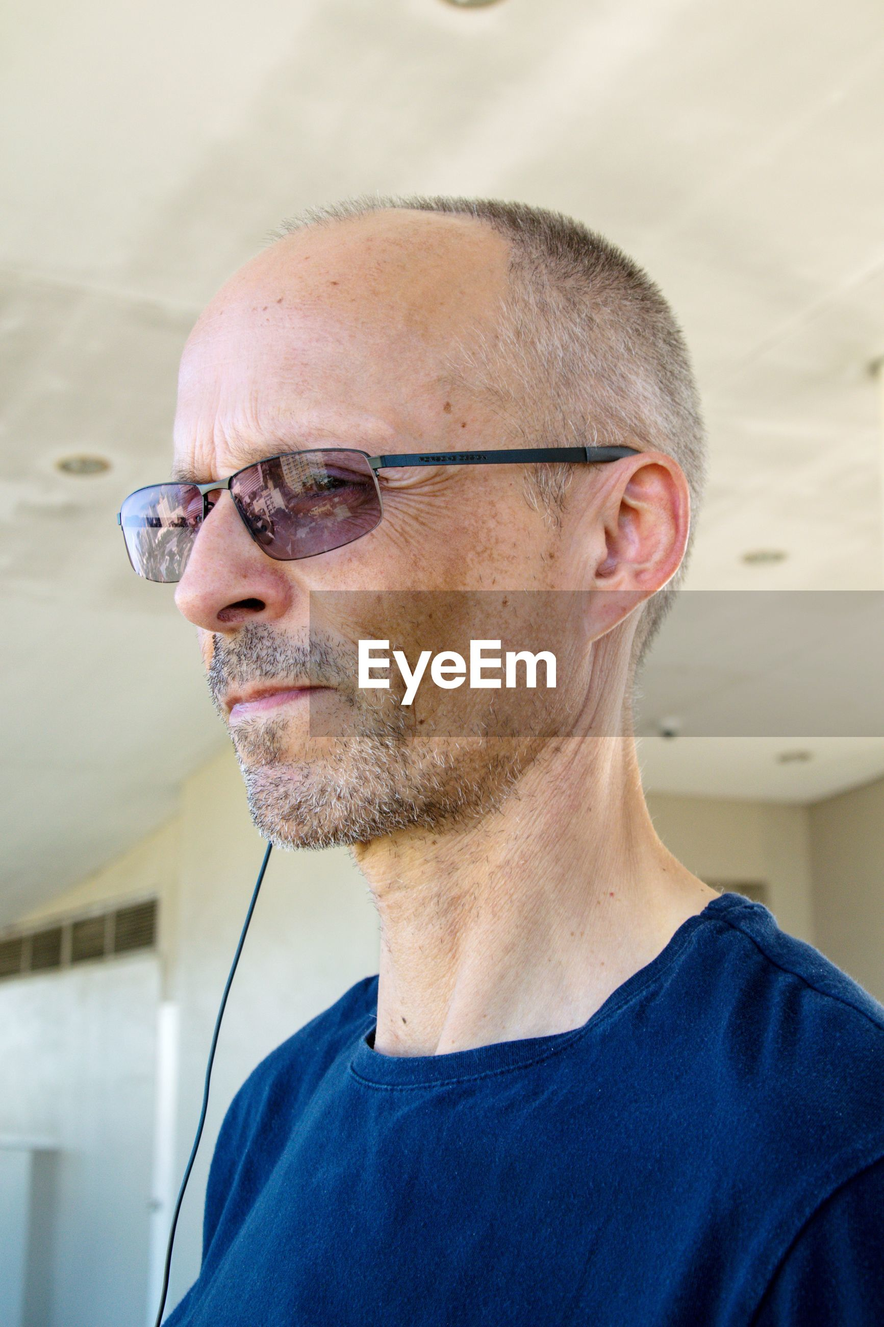 Portrait of man wearing eyeglasses
