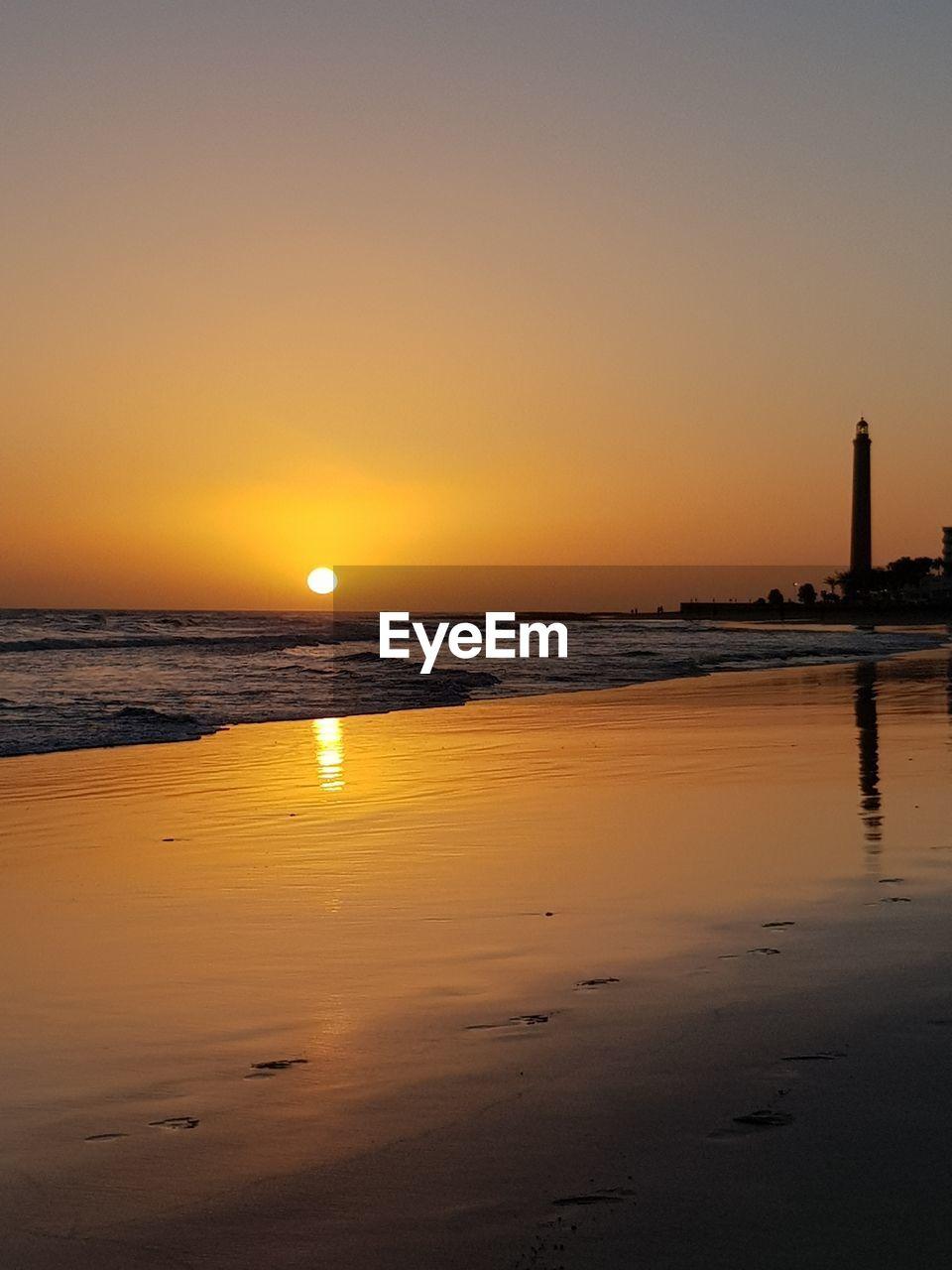 sky, water, sunset, sea, beauty in nature, scenics - nature, orange color, tranquility, beach, land, reflection, tranquil scene, sun, idyllic, nature, horizon, horizon over water, no people, non-urban scene, outdoors