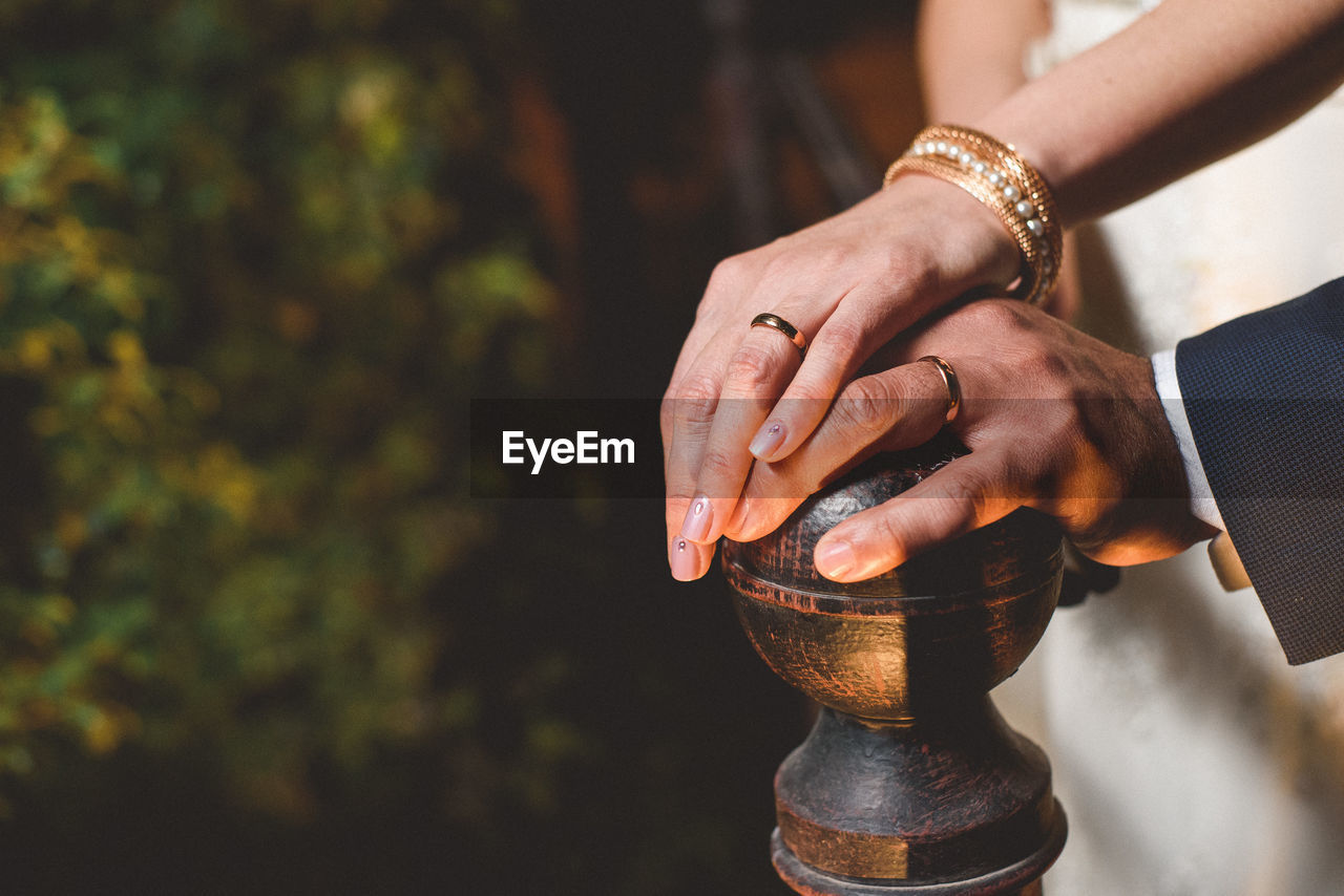 Close-Up Of Married Couple's Hands