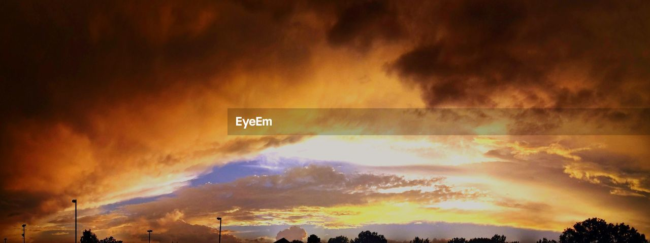 cloud - sky, sky, sunset, scenics - nature, beauty in nature, orange color, tranquil scene, low angle view, no people, tranquility, nature, dramatic sky, silhouette, idyllic, outdoors, overcast, storm, cloudscape, storm cloud, ominous