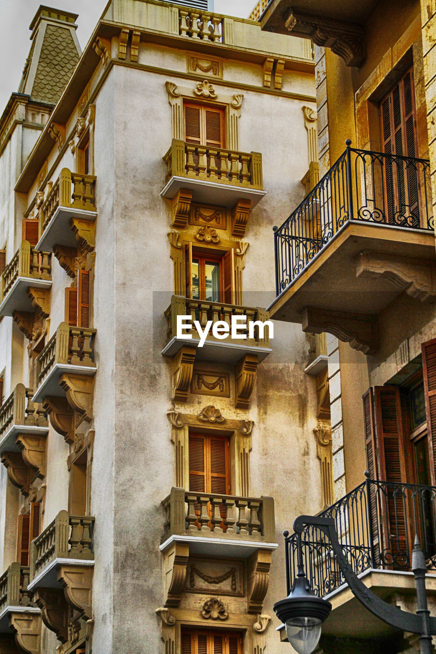 built structure, architecture, building exterior, residential district, building, no people, balcony, low angle view, day, window, railing, city, outdoors, house, staircase, apartment, entrance, travel destinations, library, book