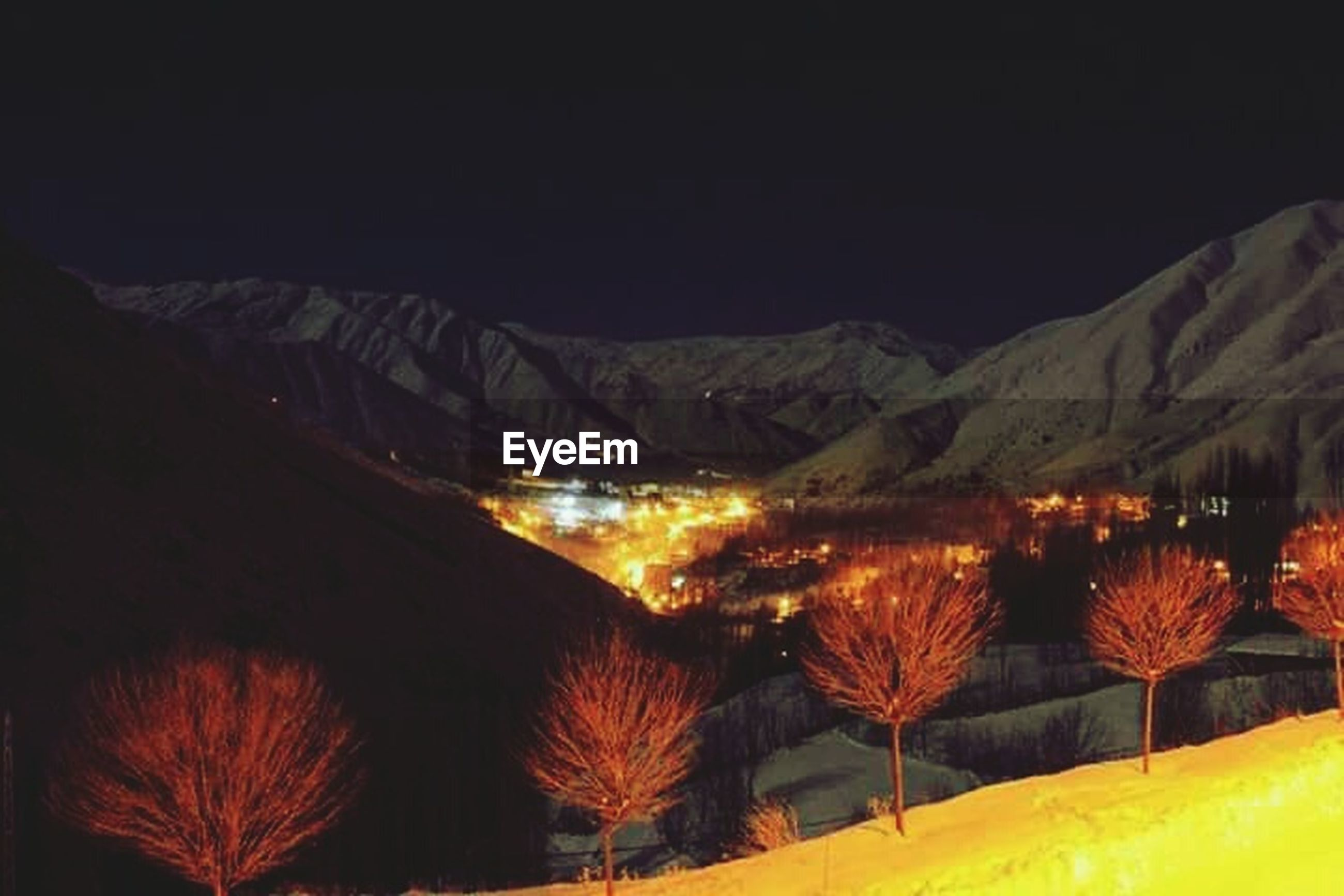 illuminated, night, mountain, clear sky, copy space, built structure, mountain range, architecture, no people, outdoors, tranquility, tranquil scene, nature, scenics, travel destinations, lighting equipment, in a row, beauty in nature, travel, culture