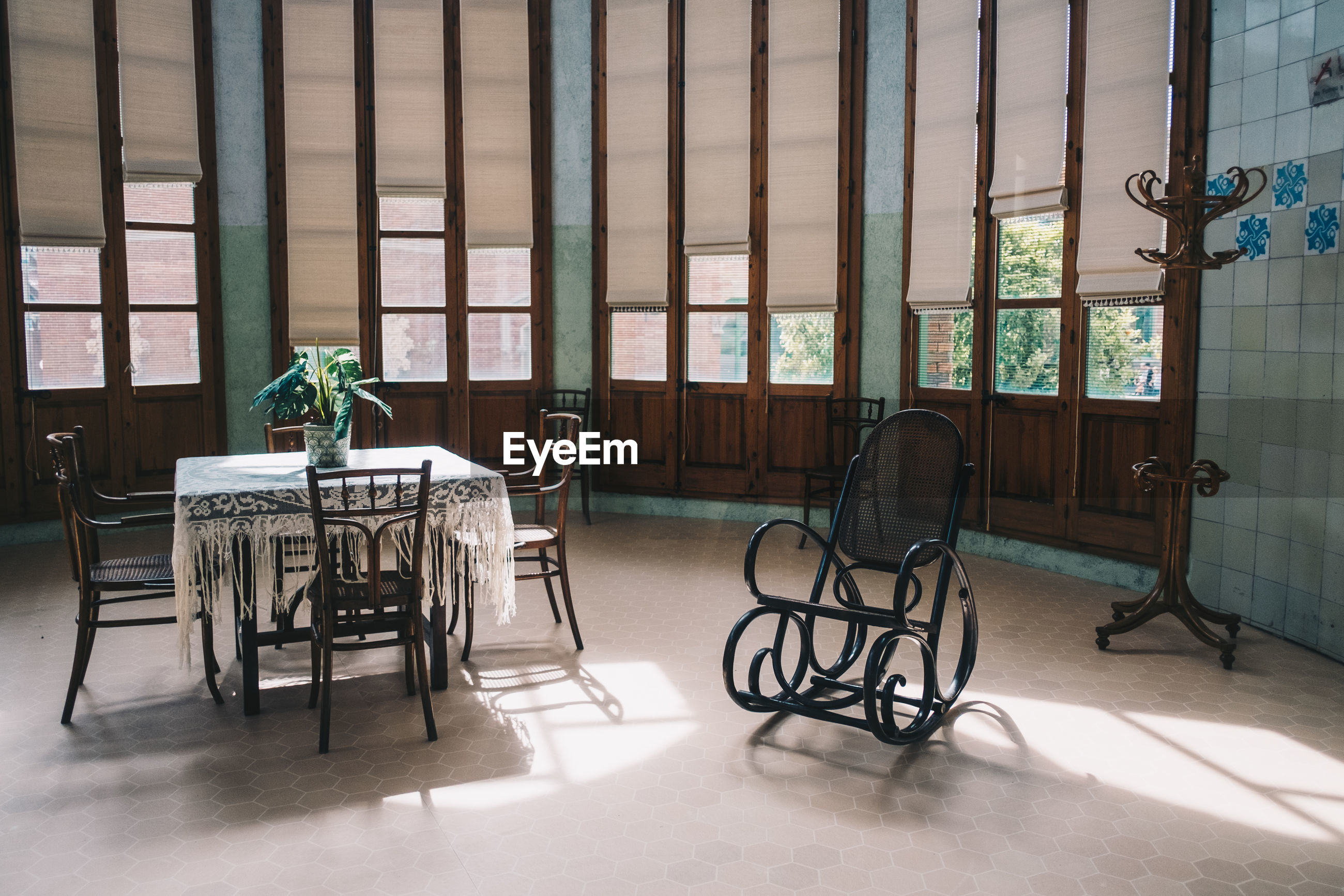 EMPTY CHAIRS AND TABLES IN ROOM