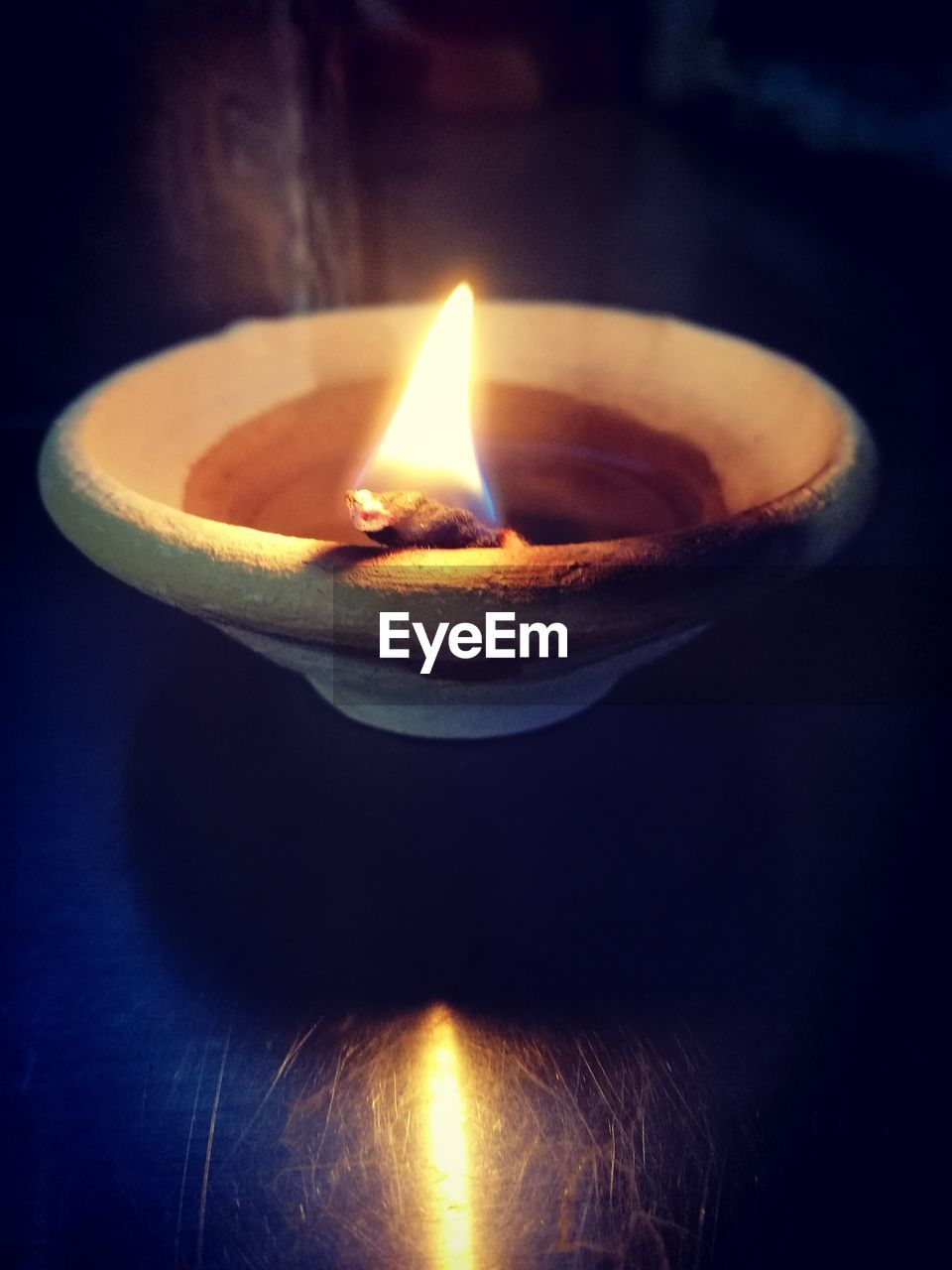 flame, burning, heat - temperature, diya - oil lamp, candle, no people, close-up, oil lamp, glowing, indoors, lighting equipment, illuminated, celebration, table, black background, diwali, night