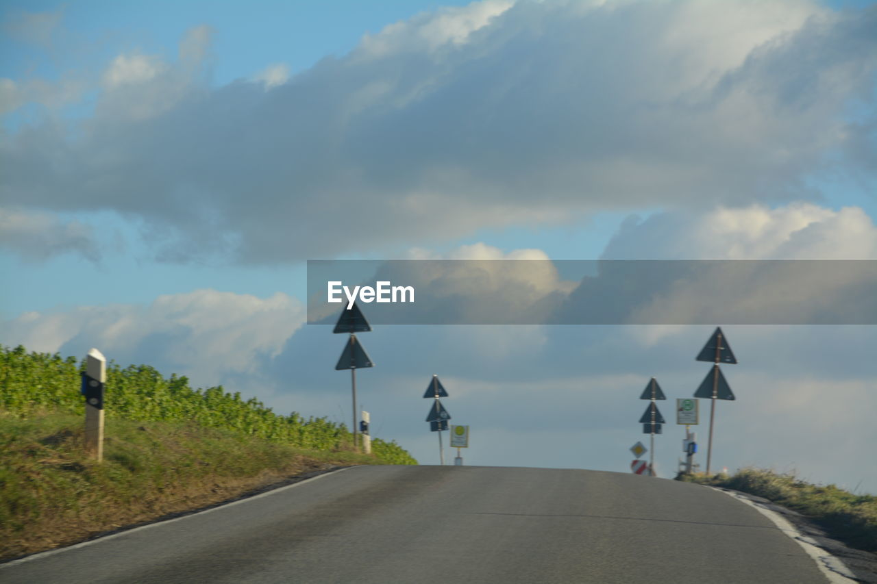 road, the way forward, transportation, cloud - sky, road sign, sky, outdoors, guidance, day, no people, nature, beauty in nature