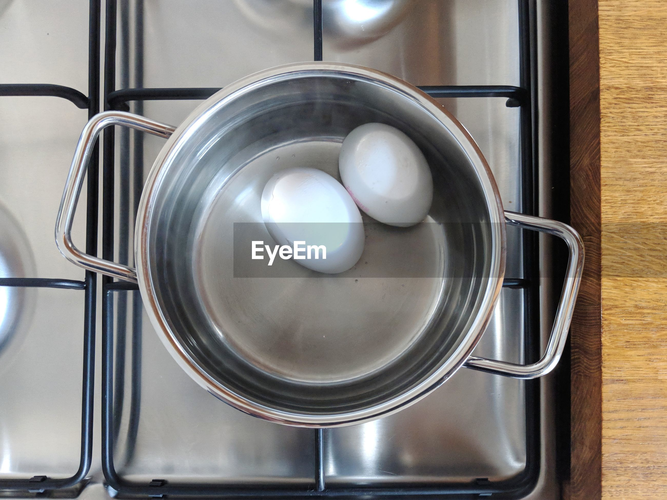 Close-up of boiled eggs in container at kitchen