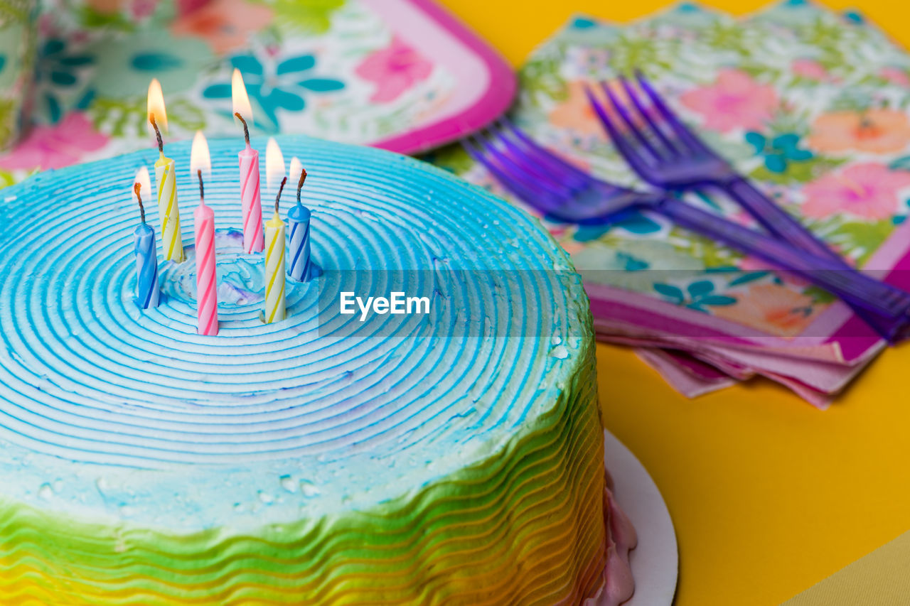 birthday, celebration, cake, anniversary, sweet, event, sweet food, candle, dessert, birthday cake, baked, multi colored, birthday candles, party - social event, indoors, no people, still life, food, food and drink, indulgence, temptation, floral pattern