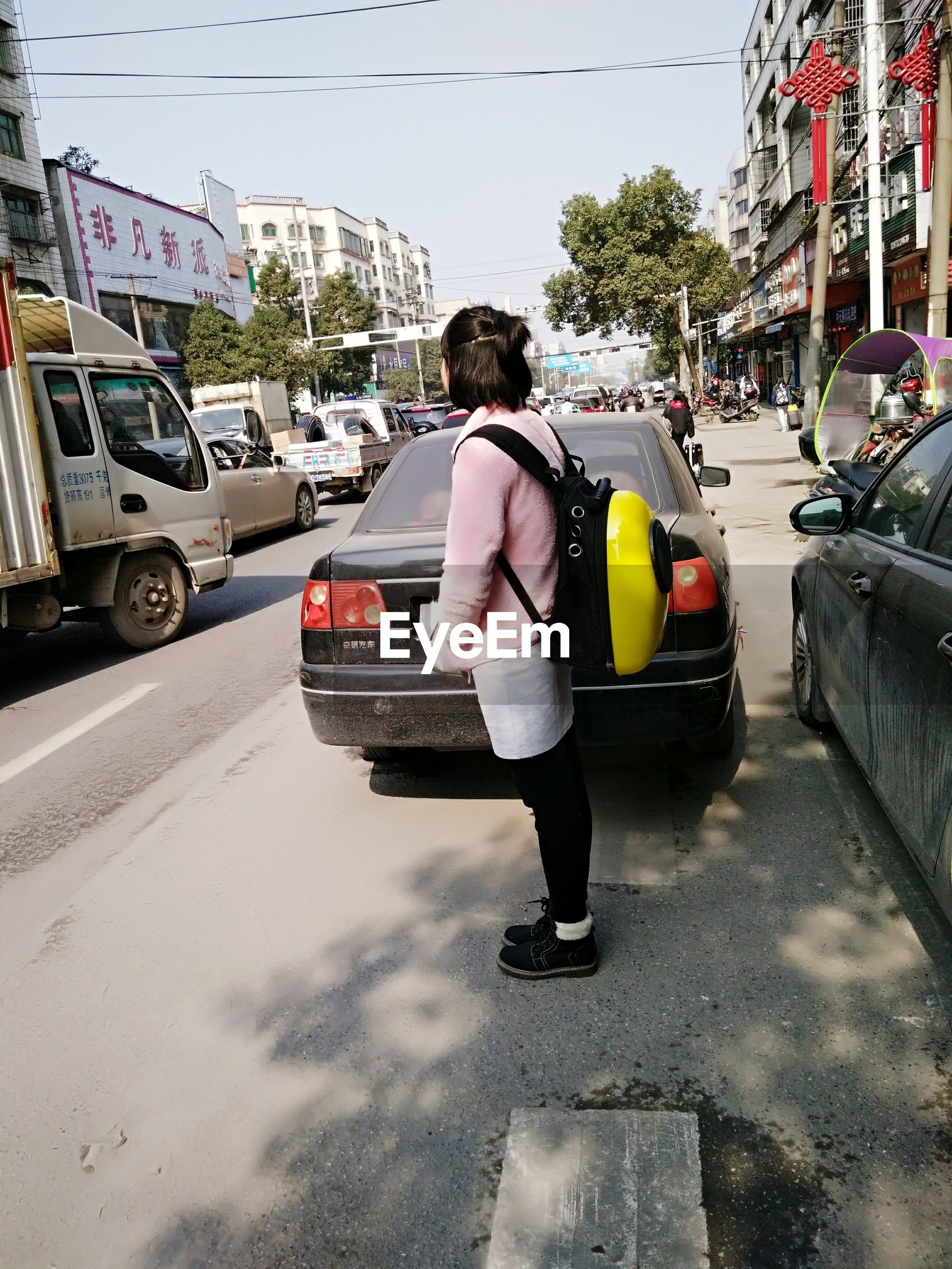 full length, car, rear view, street, adults only, transportation, one person, real people, city, walking, outdoors, adult, land vehicle, people, building exterior, road, women, day, one woman only