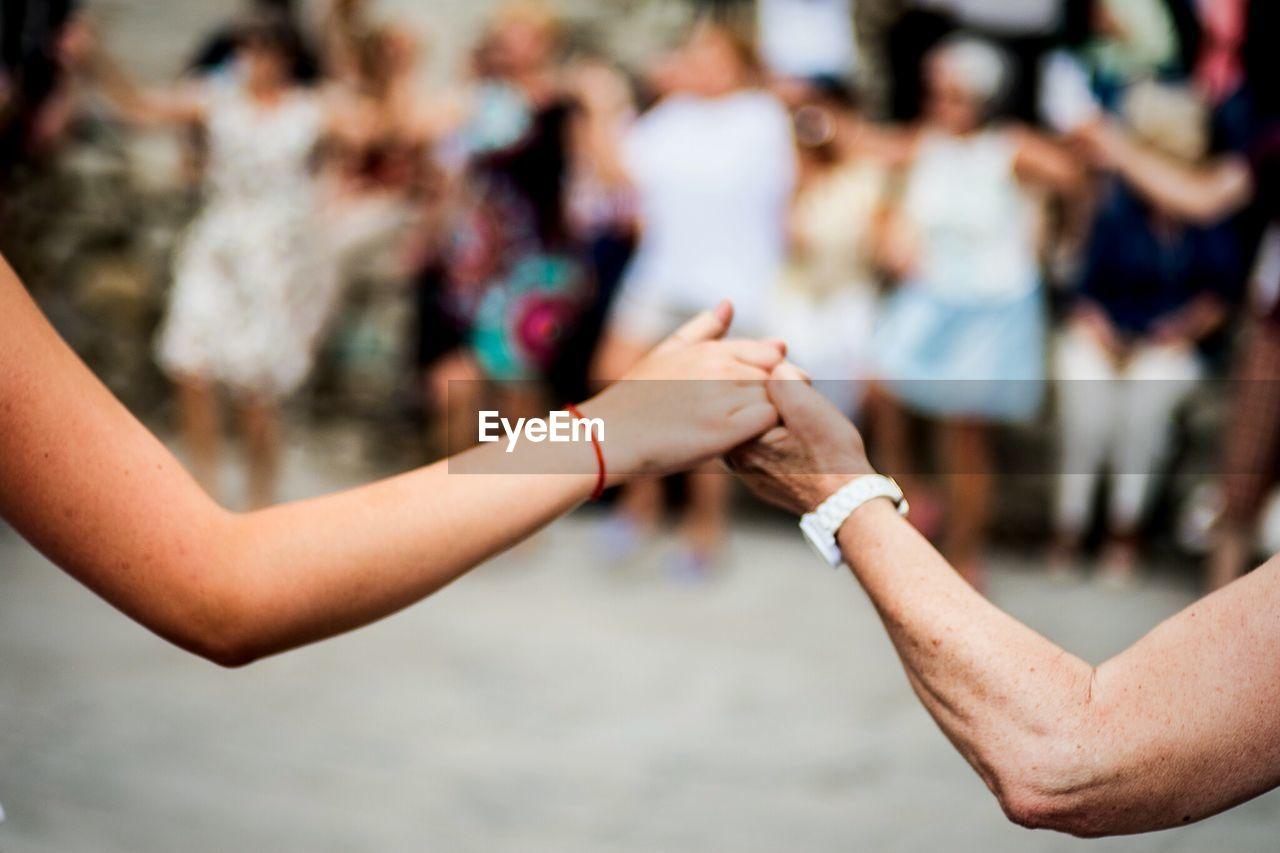 People performing sardana dance on street