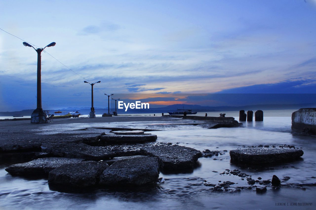 water, sea, sky, rock - object, nature, horizon over water, beauty in nature, no people, outdoors, scenics, tranquil scene, sunset, tranquility, fuel and power generation, beach, day, wind power, windmill