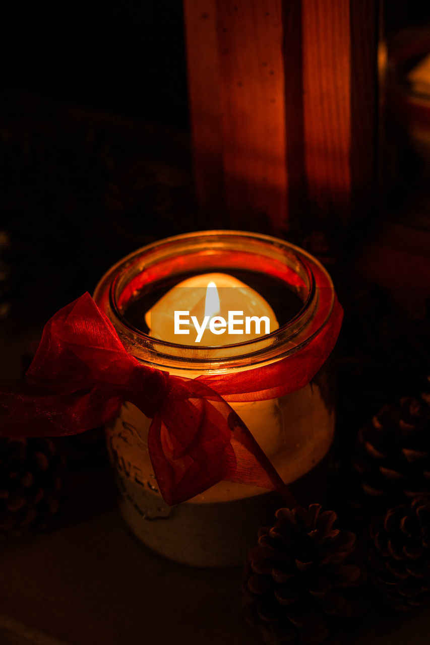 candle, fire, burning, flame, fire - natural phenomenon, illuminated, heat - temperature, glowing, tea light, no people, indoors, nature, close-up, flower, container, beauty in nature, flowering plant, oil lamp, lighting equipment, high angle view, dark, electric lamp
