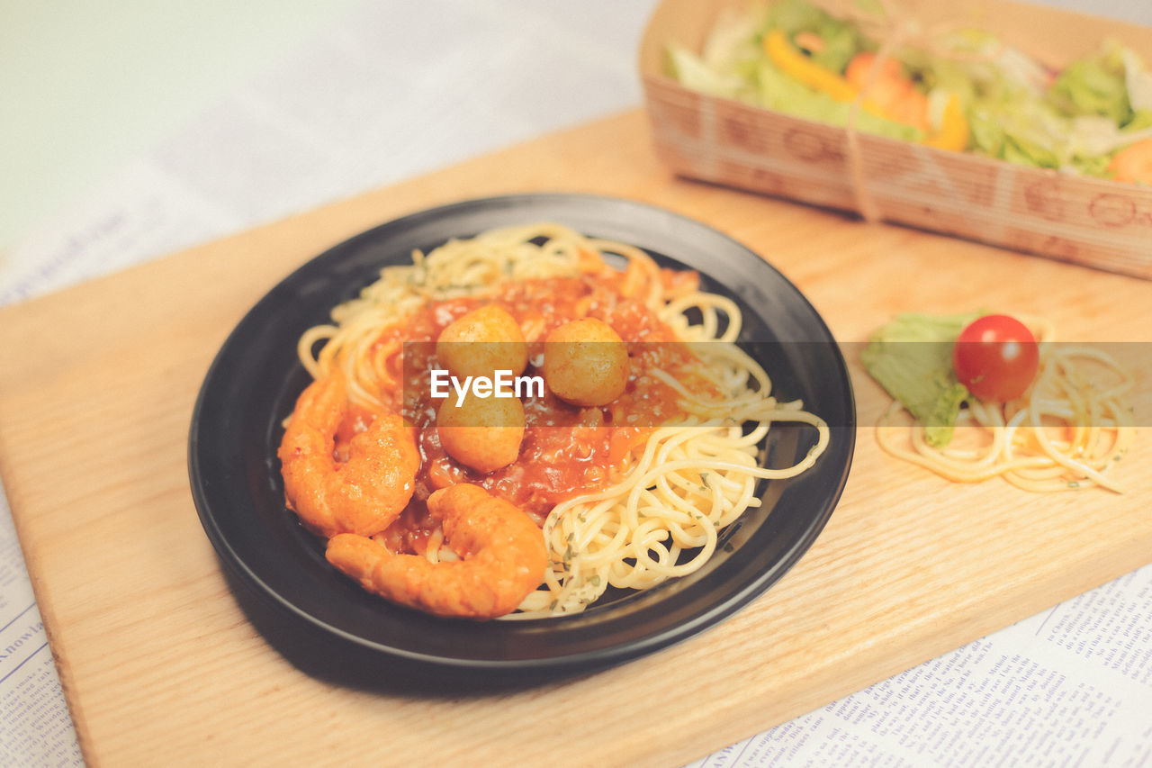 food, food and drink, freshness, ready-to-eat, table, healthy eating, tomato, wellbeing, vegetable, fruit, italian food, indoors, pasta, still life, close-up, no people, serving size, high angle view, plate, wood - material, japanese food, temptation, spaghetti, place mat