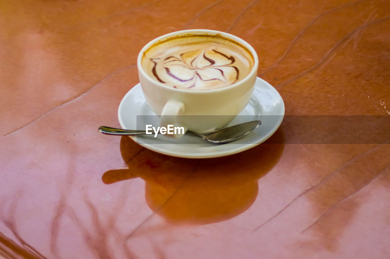 food and drink, drink, refreshment, saucer, coffee cup, coffee - drink, high angle view, frothy drink, table, indoors, freshness, cappuccino, froth art, no people, healthy eating, food, close-up, day