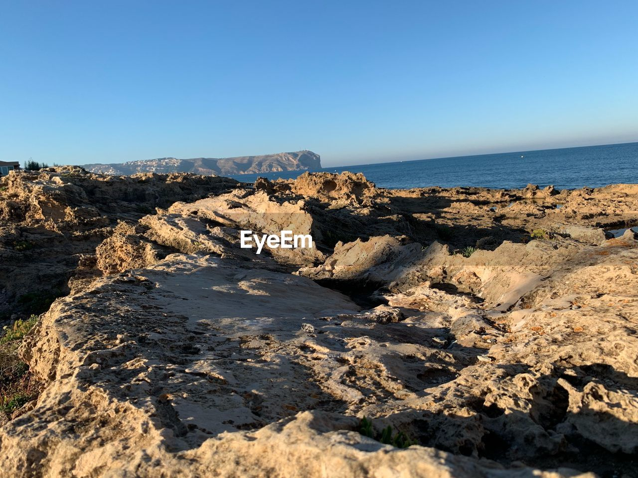 sky, sea, rock, rock - object, beauty in nature, scenics - nature, water, solid, clear sky, horizon, land, rock formation, tranquil scene, tranquility, nature, horizon over water, beach, copy space, day, no people, eroded, rocky coastline