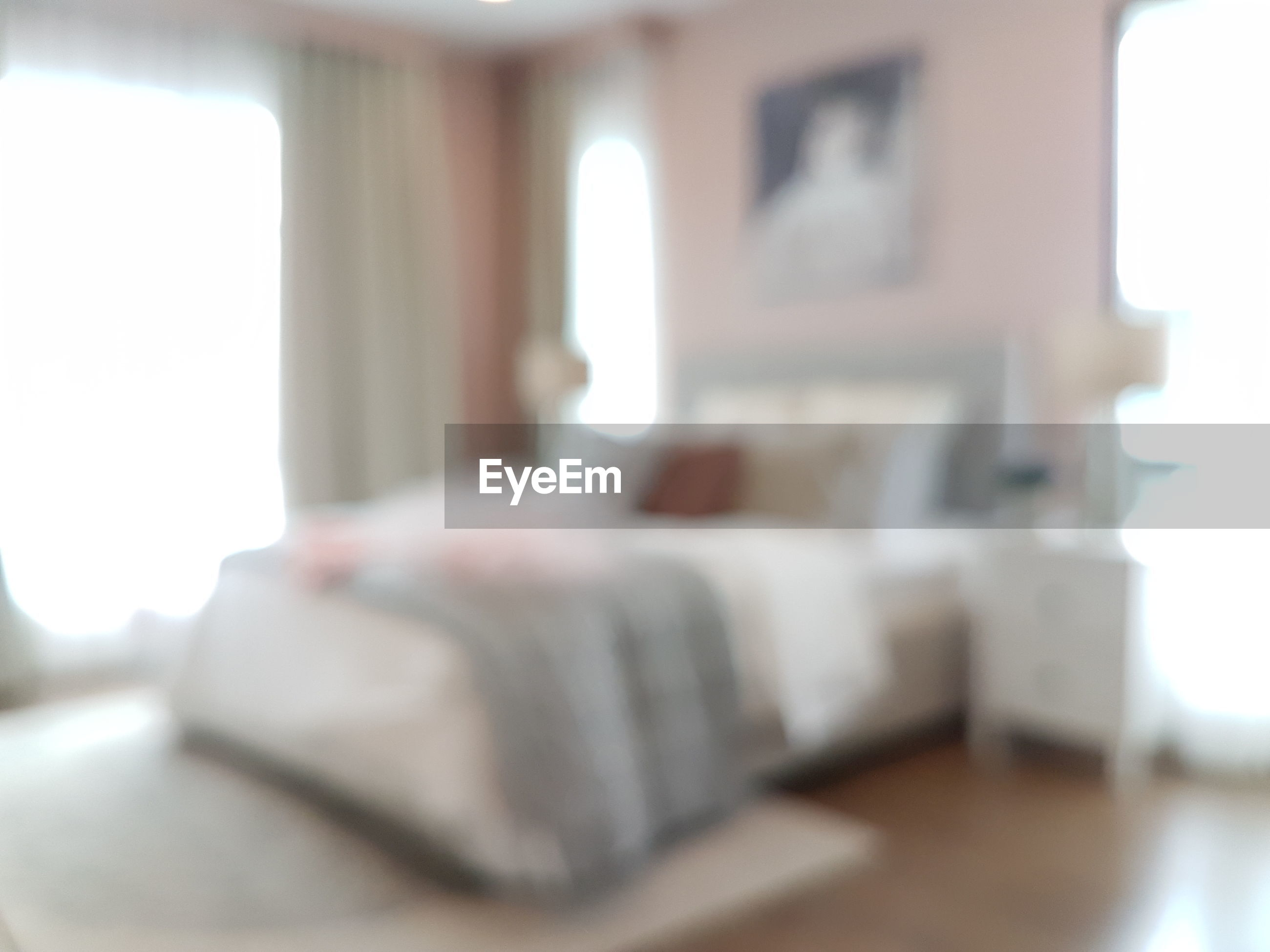 Defocused image of bed at home