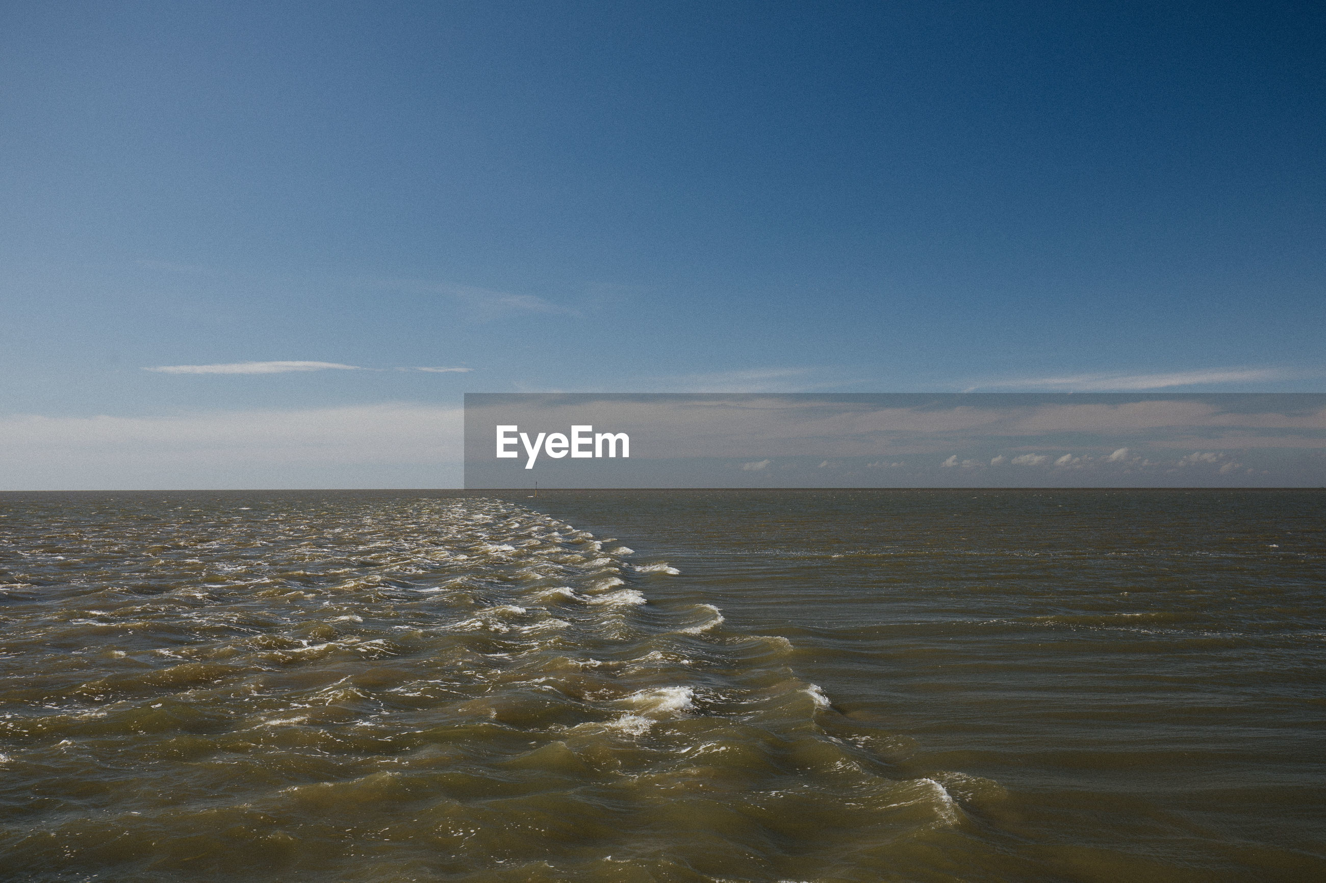 VIEW OF SEA AGAINST BLUE SKY