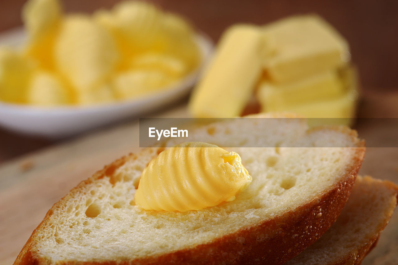 Close-Up Of Butter On Bread At Table
