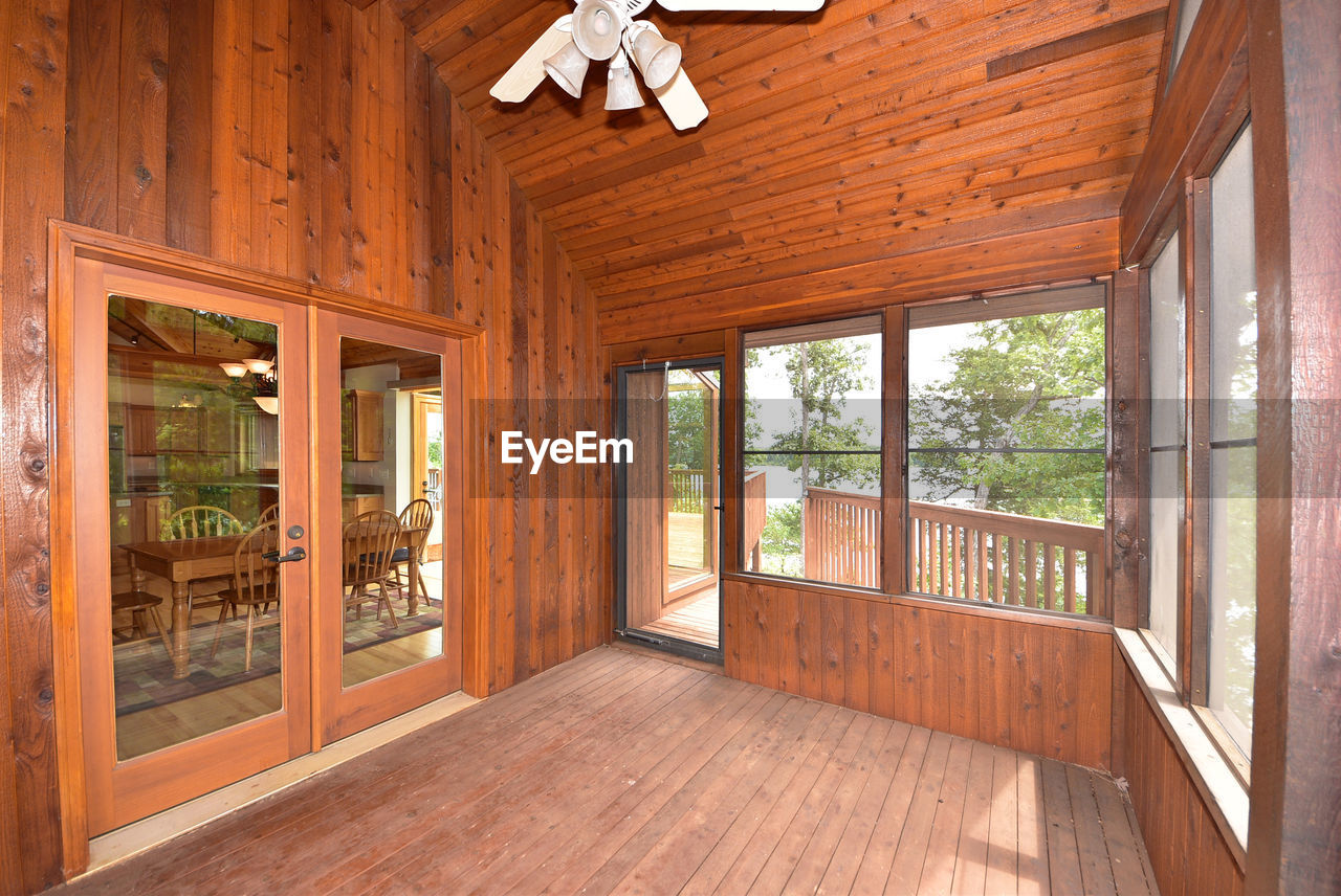 wood - material, window, indoors, home interior, day, hardwood floor, architecture, no people, wood paneling, nature, tree