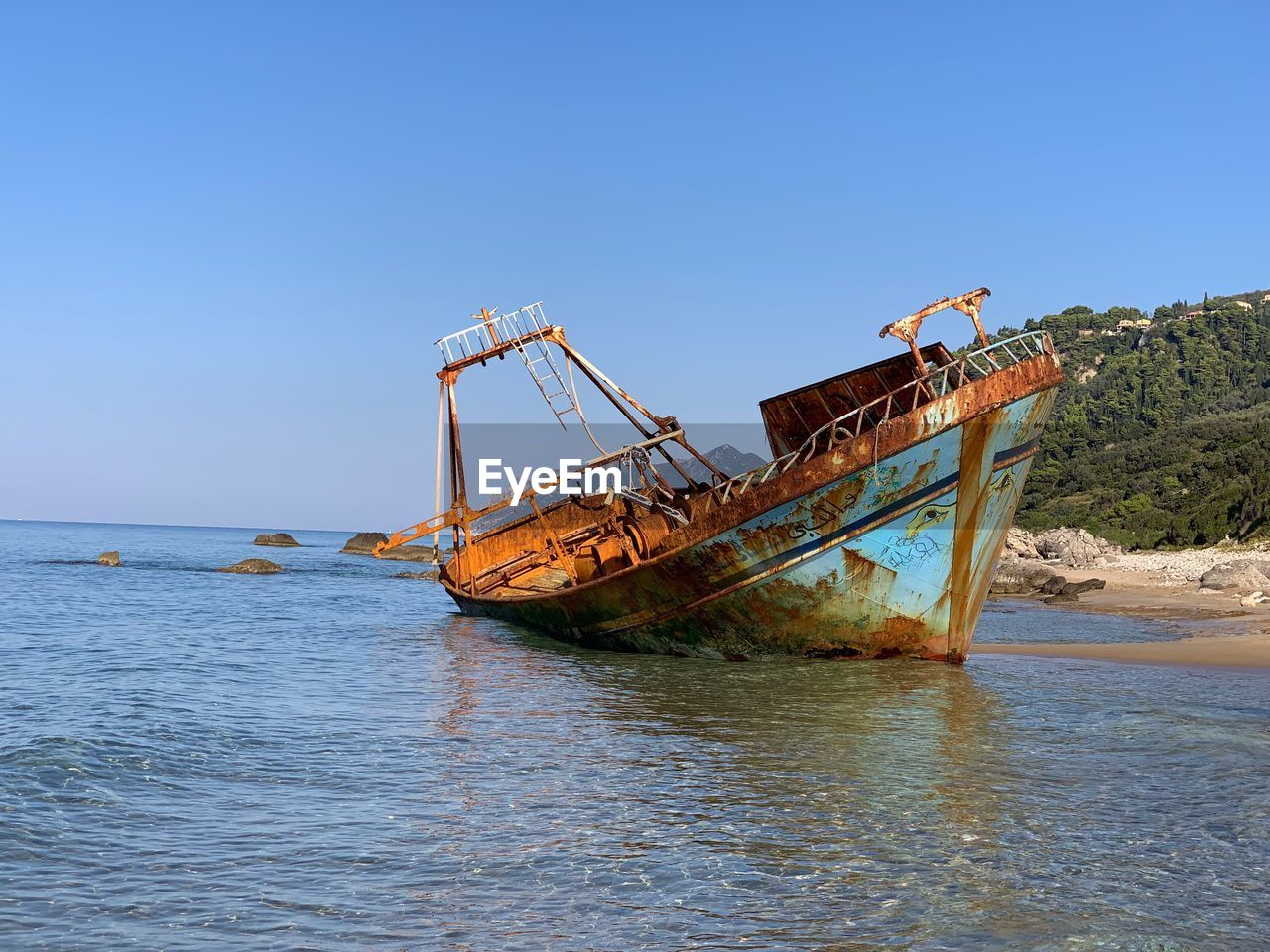 sky, water, sea, clear sky, nature, abandoned, nautical vessel, copy space, day, ship, transportation, shipwreck, waterfront, mode of transportation, blue, obsolete, no people, scenics - nature, damaged, outdoors, deterioration, sinking