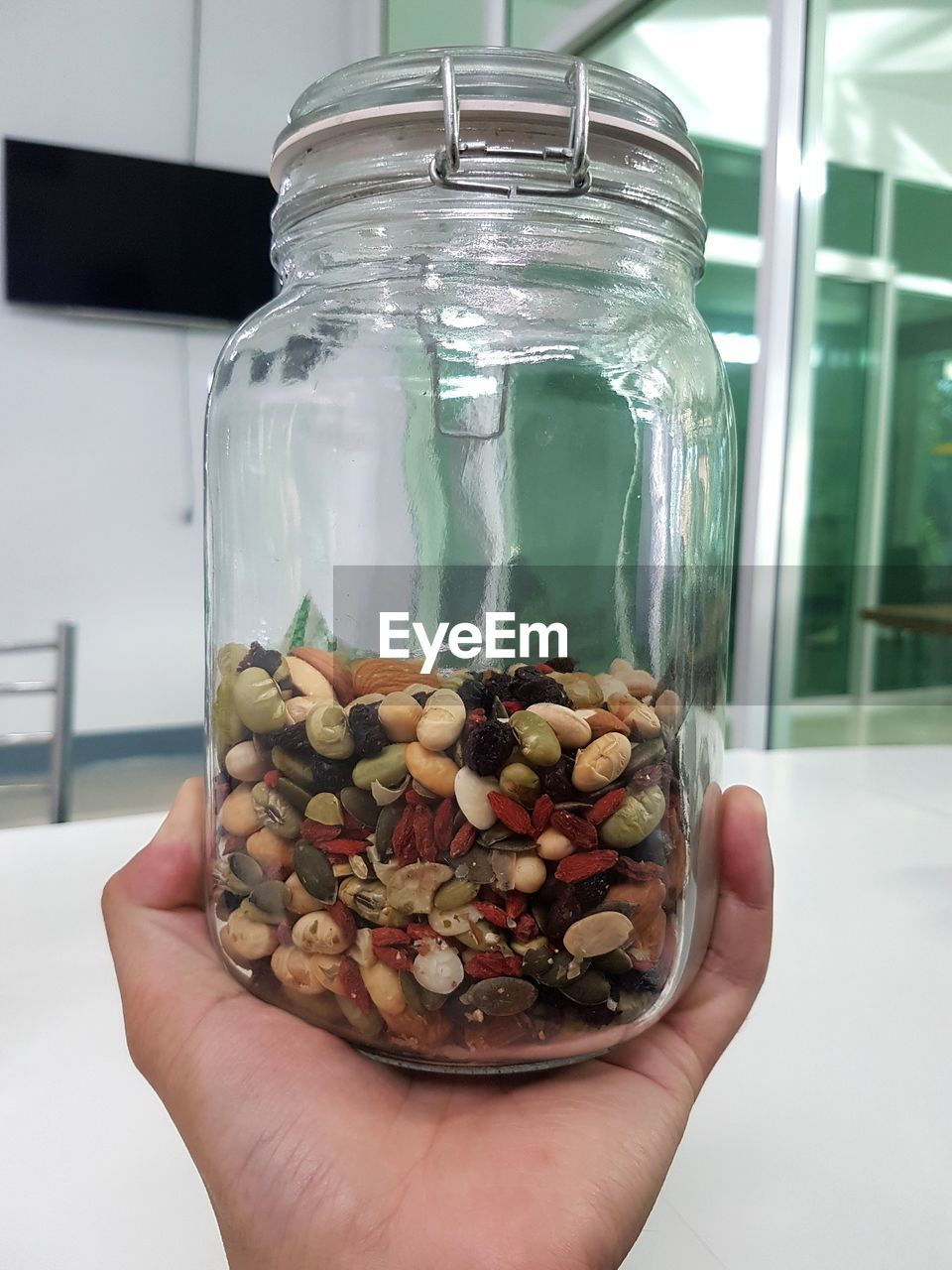 human hand, one person, jar, hand, holding, transparent, human body part, real people, container, glass - material, unrecognizable person, close-up, focus on foreground, indoors, lifestyles, finger, personal perspective, human finger, body part