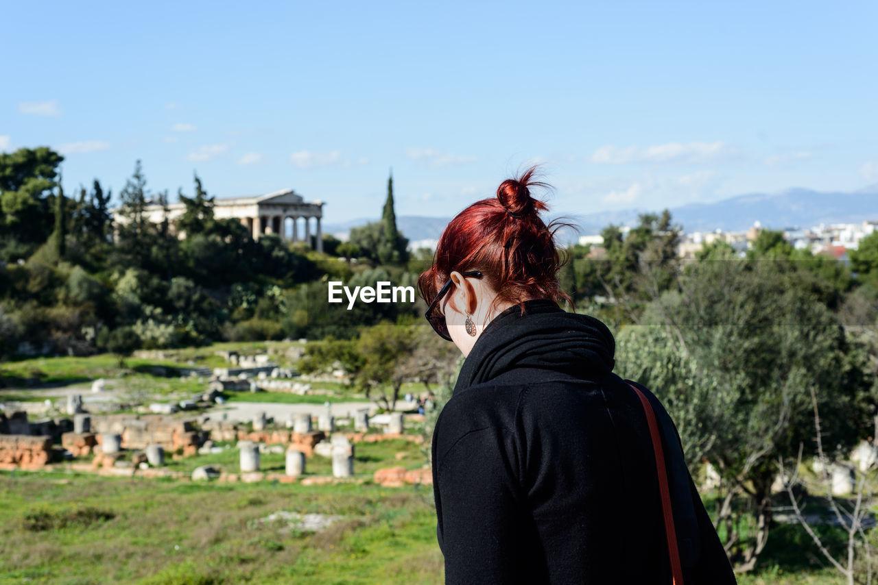 Woman Visiting Ancient Civilization Against Sky
