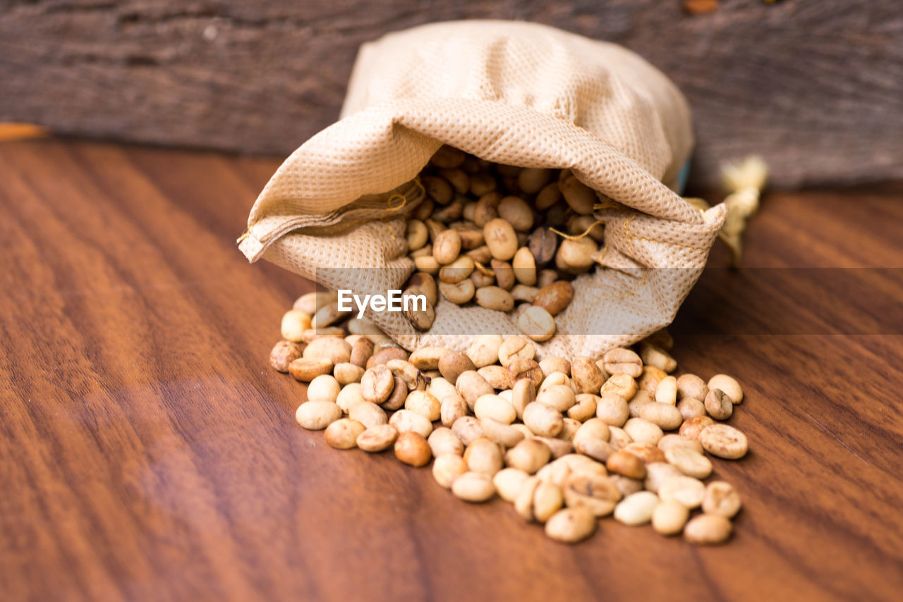 Close-Up Of Beans In Sack On Table