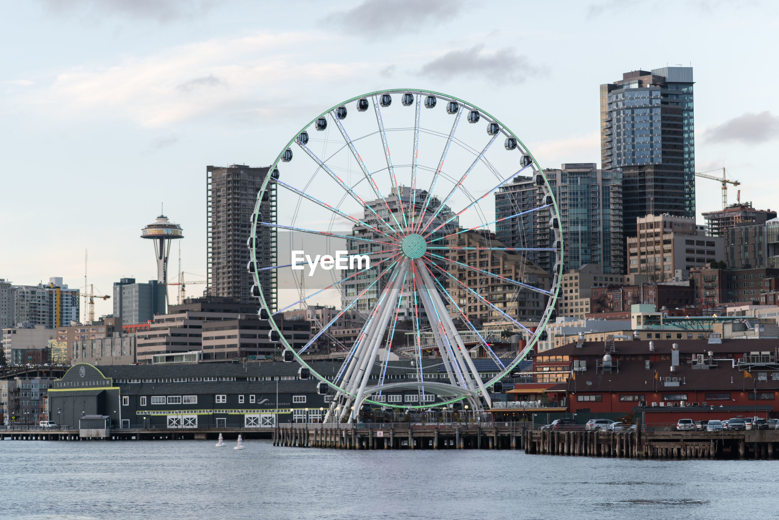 FERRIS WHEEL WITH CITY IN BACKGROUND