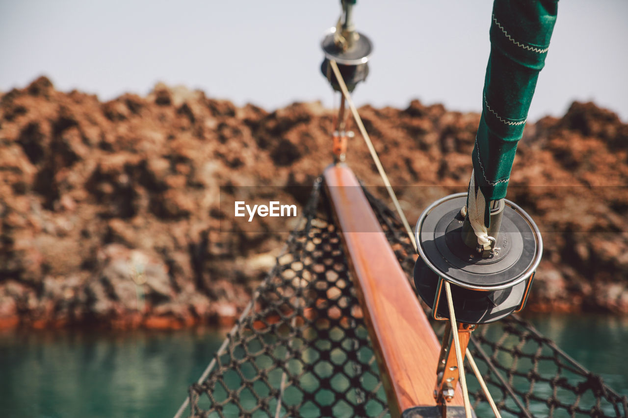 hanging, focus on foreground, rope, water, no people, outdoors, day, close-up, clear sky, nautical vessel, sea, moored, sky, fishing tackle, nature
