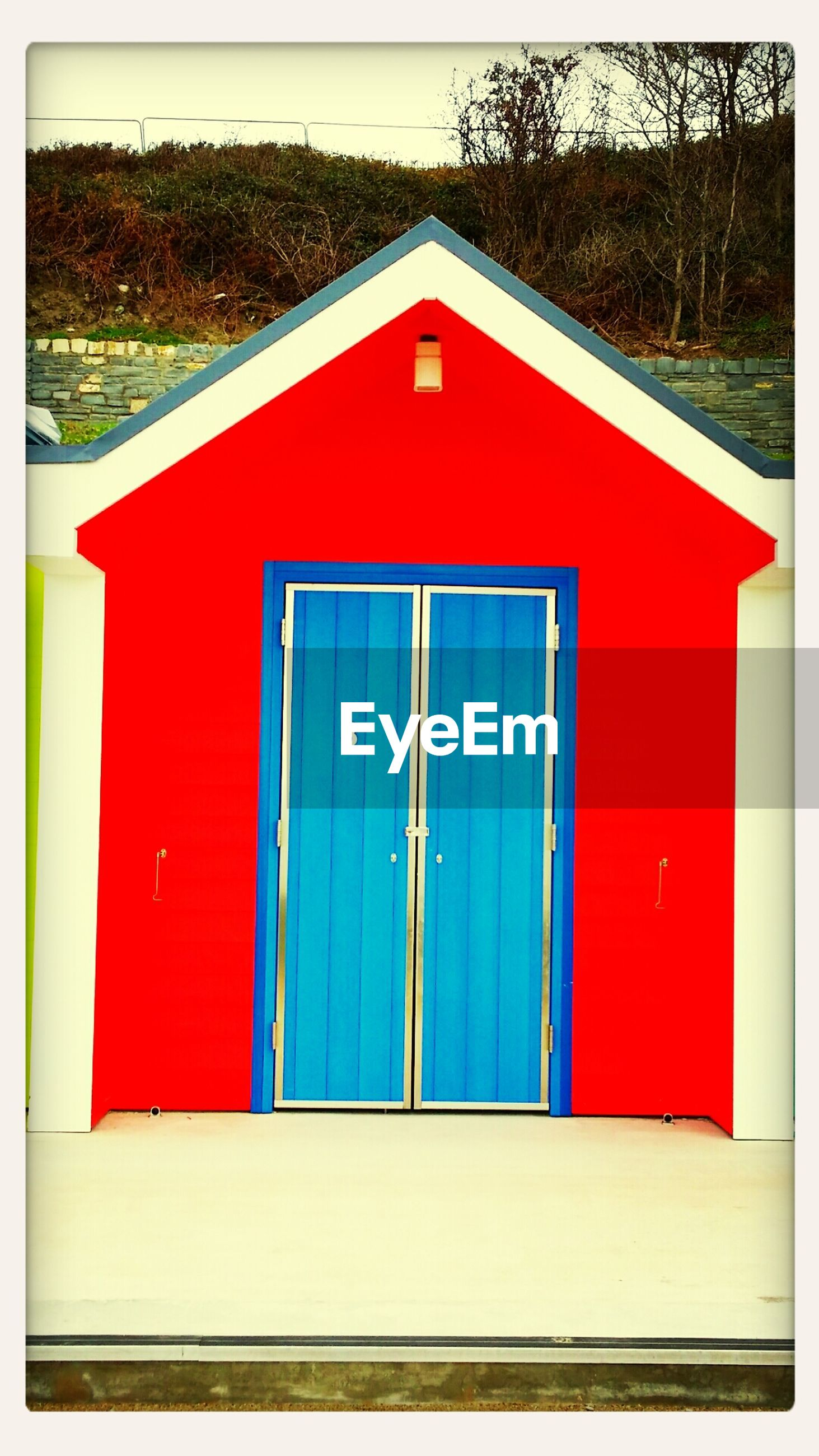 transfer print, red, building exterior, built structure, architecture, closed, door, auto post production filter, house, day, window, outdoors, wood - material, safety, no people, protection, entrance, grass, security, residential structure