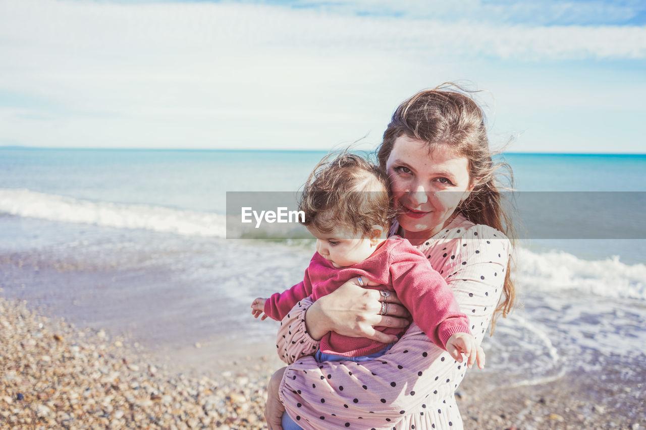 HAPPY GIRL ON BEACH BY SEA SHORE