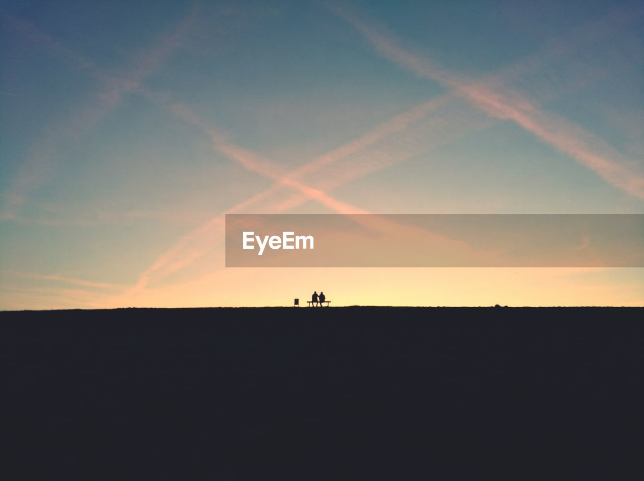 sky, sunset, silhouette, beauty in nature, landscape, scenics - nature, environment, nature, tranquil scene, cloud - sky, tranquility, land, real people, leisure activity, two people, field, lifestyles, dusk, non-urban scene, outdoors, vapor trail
