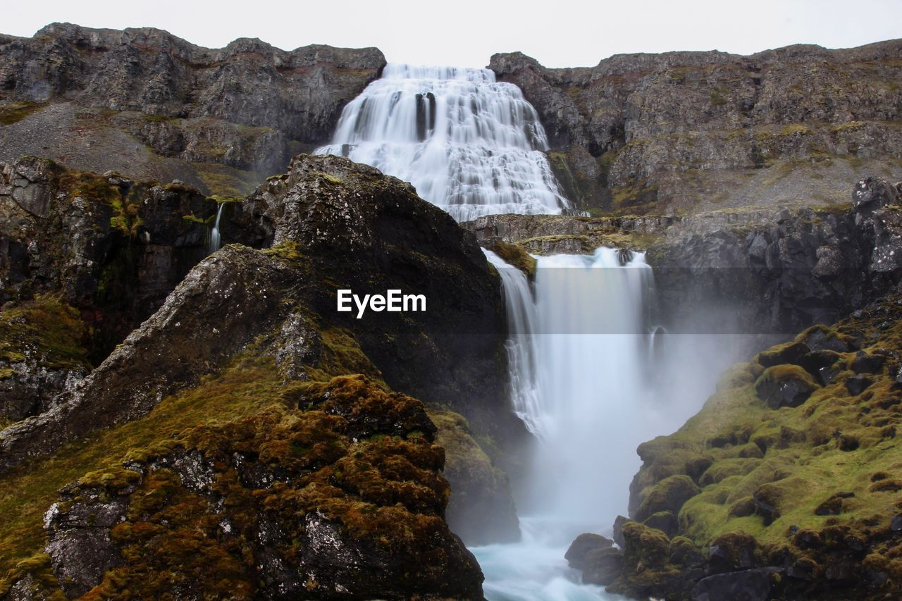 waterfall, rock, scenics - nature, rock - object, water, rock formation, solid, motion, long exposure, beauty in nature, nature, flowing water, power, environment, blurred motion, travel destinations, land, power in nature, non-urban scene, flowing, no people, outdoors, falling water, formation